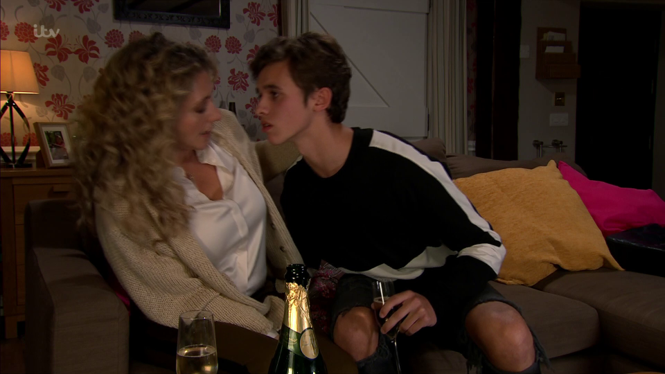 Jacob and Maya drinking together before they kiss