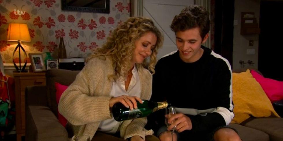 Maya Jacob drinking champagne before they kiss