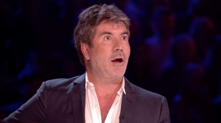Louis Tomlinson shuts down Simon Cowell in live X Factor clash