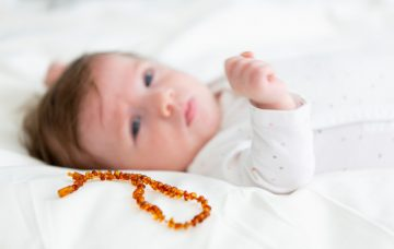 Toddler with teething necklace