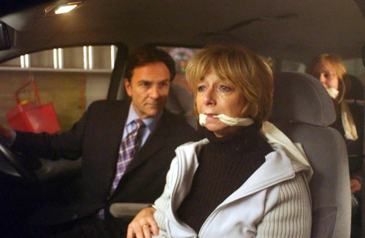ITV ARCHIVE 'Coronation Street' TV - 2003 - Richard Hillman (Brian Capron) has taken the rest of the family hostage. Gail Hillman (Helen Worth) is terrified when she finds Sarah Platt (Tina O'Brien) and David Platt (Jack P Shepherd) tied up in the back of their people carrier. Has Richard finally lost it? 2003 Image ID: 697529aw Featured in: ITV ARCHIVE Photo Credit: ITV/Shutterstock