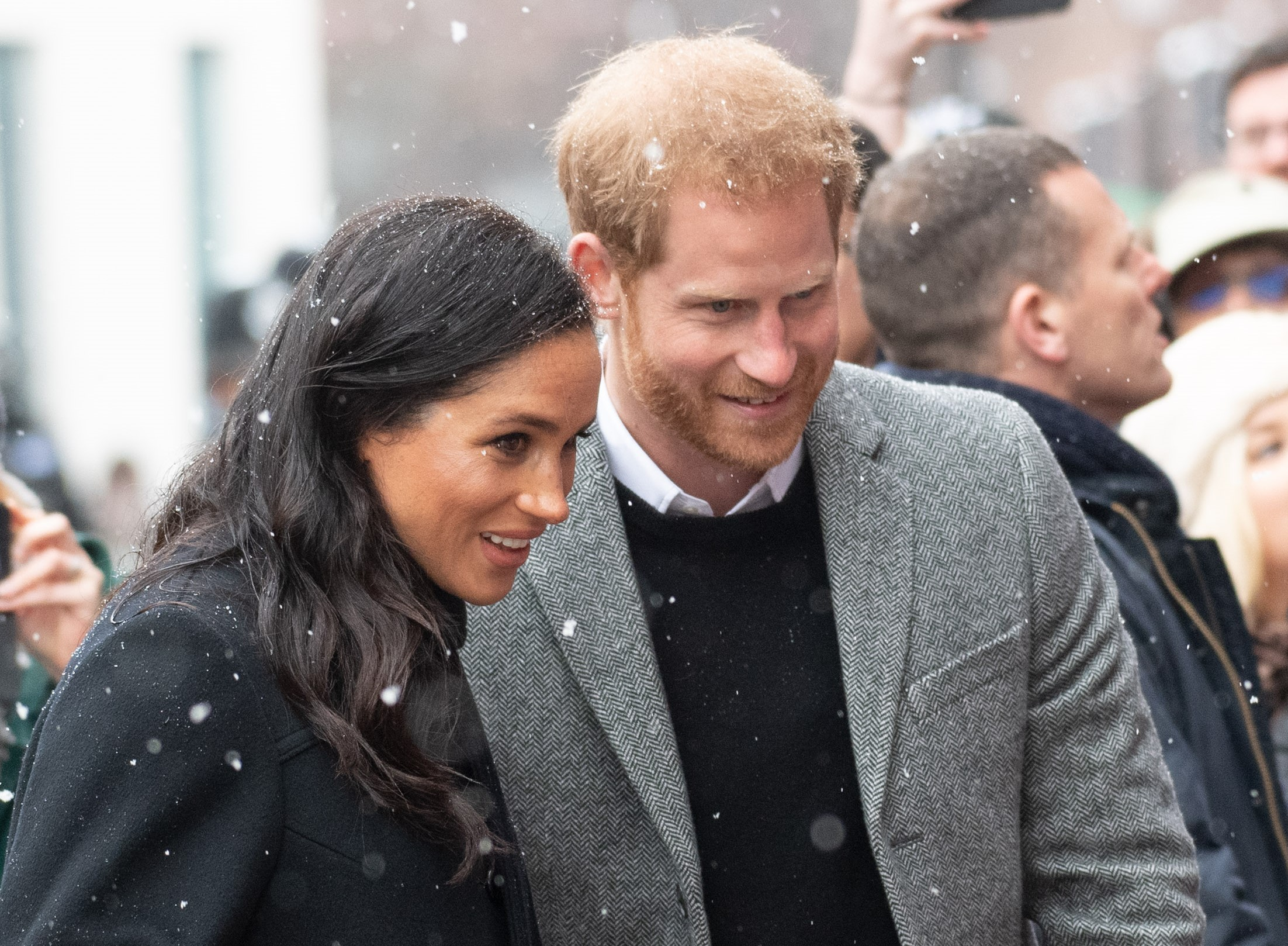 Pregnant Meghan Markle braves the snow with Prince Harry for royal visit