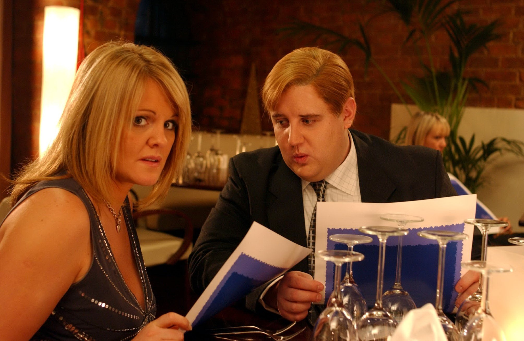 Editorial use only. Exclusive - Premium Rates Apply. Call your Account Manager for pricing. Mandatory Credit: Photo by ITV/REX/Shutterstock (709206kk) 'Coronation Street' TV - 2004 - After some initial reservations Shelley Unwin (SALLY LINDSAY) is pleasantly surprised when drayman Eric Gartside (PETER KAY) takes her out to a posh restaurant. ITV ARCHIVE