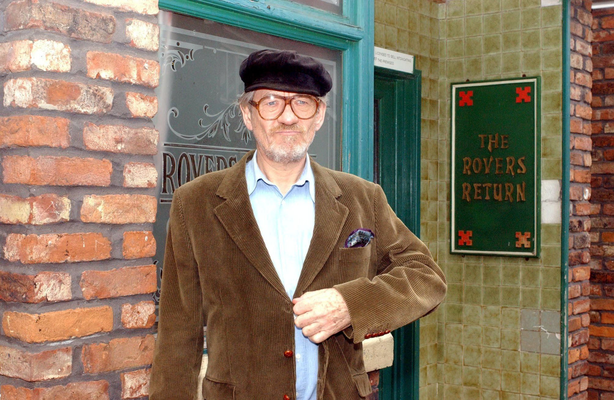 Editorial use only. Exclusive - Premium Rates Apply. Call your Account Manager for pricing. Mandatory Credit: Photo by ITV/REX/Shutterstock (689861cx) 'Coronation Street' TV - 2005 - Author Mel Hutchwright (Sir Ian McKellen) ITV ARCHIVE