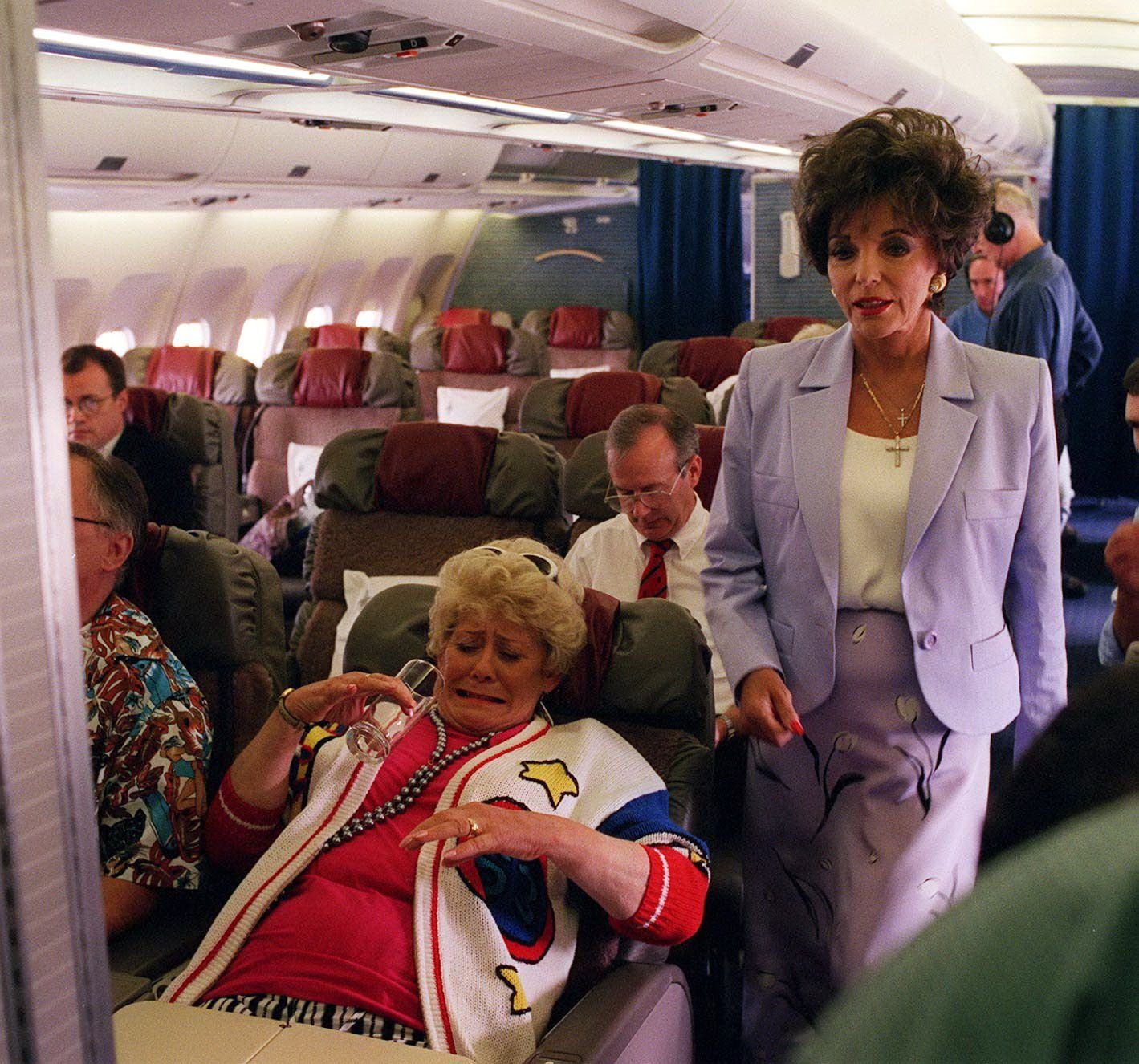 Editorial use only. Exclusive - Premium Rates Apply. Call your Account Manager for pricing. Mandatory Credit: Photo by ITV/REX/Shutterstock (852820nl) 'Coronation Street' TV - 1997 - Las Vegas - Vera Duckworth [Liz Dawn] on plane with Joan Collins. ITV ARCHIVE