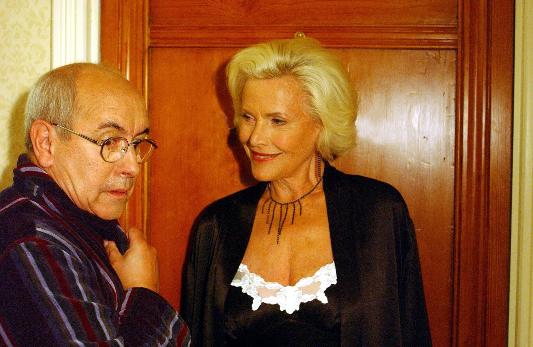 Editorial use only. Exclusive - Premium Rates Apply. Call your Account Manager for pricing. Mandatory Credit: Photo by ITV/REX/Shutterstock (726940cp) 'Coronation Street' TV - 2004 - Norris Cole [Malcolm Hebden] and Rula Romanoff [Honor Blackman]. ITV ARCHIVE