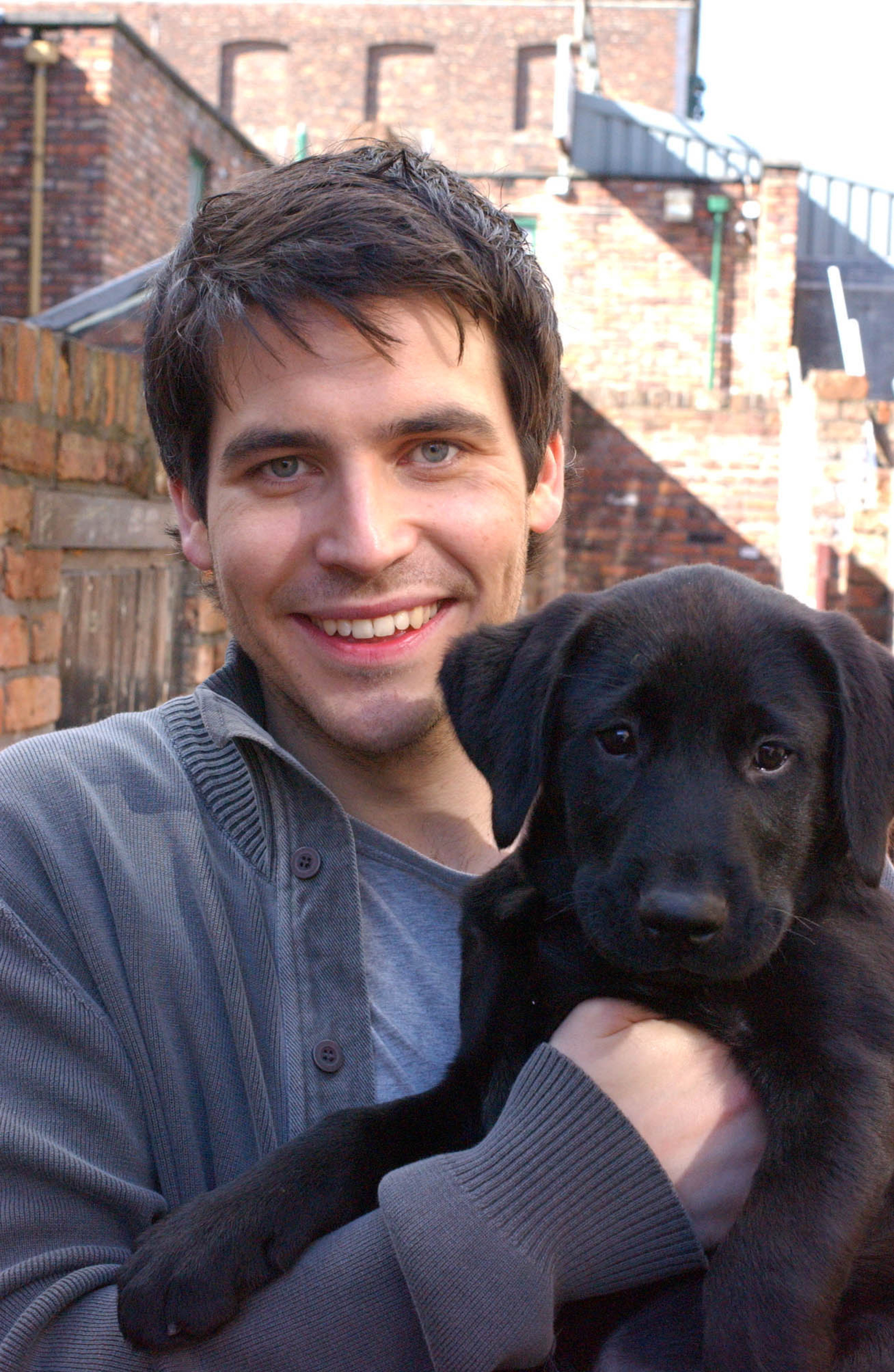 Editorial use only. Exclusive - Premium Rates Apply. Call your Account Manager for pricing. Mandatory Credit: Photo by ITV/REX/Shutterstock (805535ik) 'Coronation Street' TV - 2007 - , Maria Sutherland buys Liam Connor [Rob James -Collier] a present - a puppy called Ozzy. ITV ARCHIVE