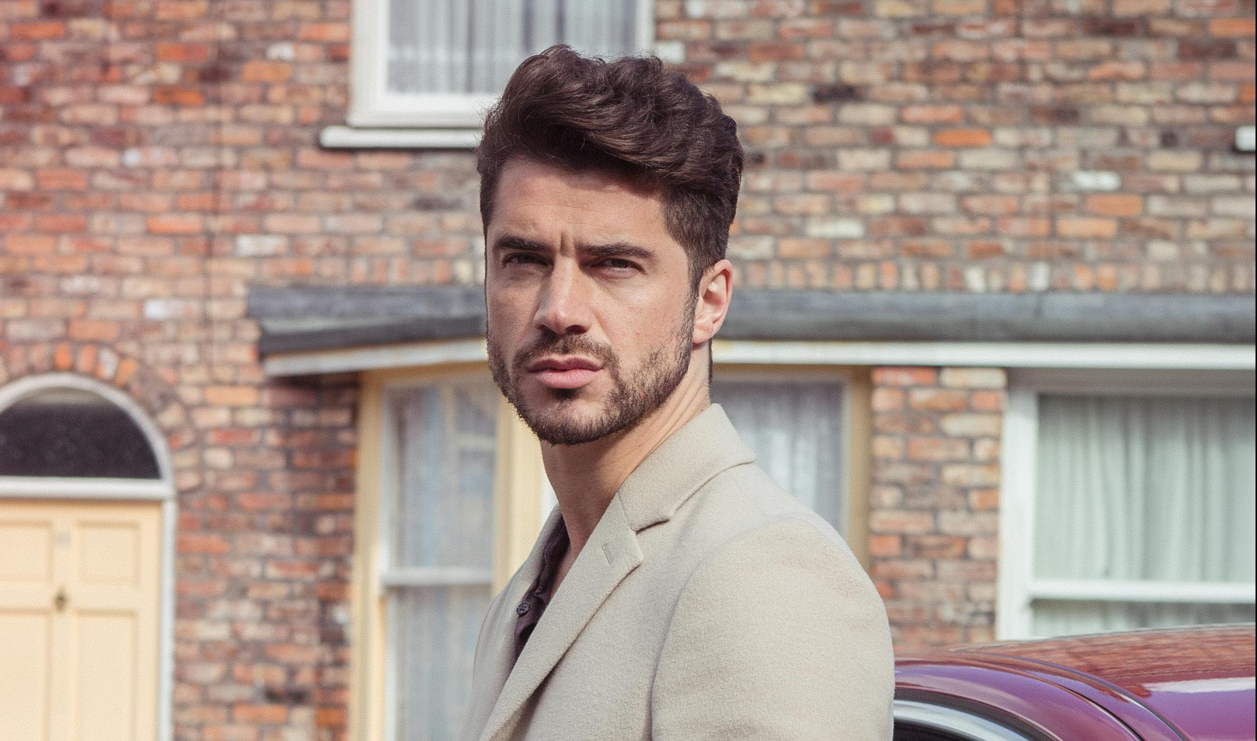 FROM ITV STRICT EMBARGO Tuesday 8 November 2016 Coronation Street - Ep 9035 Wednesday 16 November 2016 A flashy new Jaguar sweeps onto Coronation Street and parks outside Underworld. Adam Barlow [SAM ROBERTSON] steps out Picture contact: david.crook@itv.com on 0161 952 6214 Photographer - Mark Bruce This photograph is (C) ITV Plc and can only be reproduced for editorial purposes directly in connection with the programme or event mentioned above, or ITV plc. Once made available by ITV plc Picture Desk, this photograph can be reproduced once only up until the transmission [TX] date and no reproduction fee will be charged. Any subsequent usage may incur a fee. This photograph must not be manipulated [excluding basic cropping] in a manner which alters the visual appearance of the person photographed deemed detrimental or inappropriate by ITV plc Picture Desk. This photograph must not be syndicated to any other company, publication or website, or permanently archived, without the