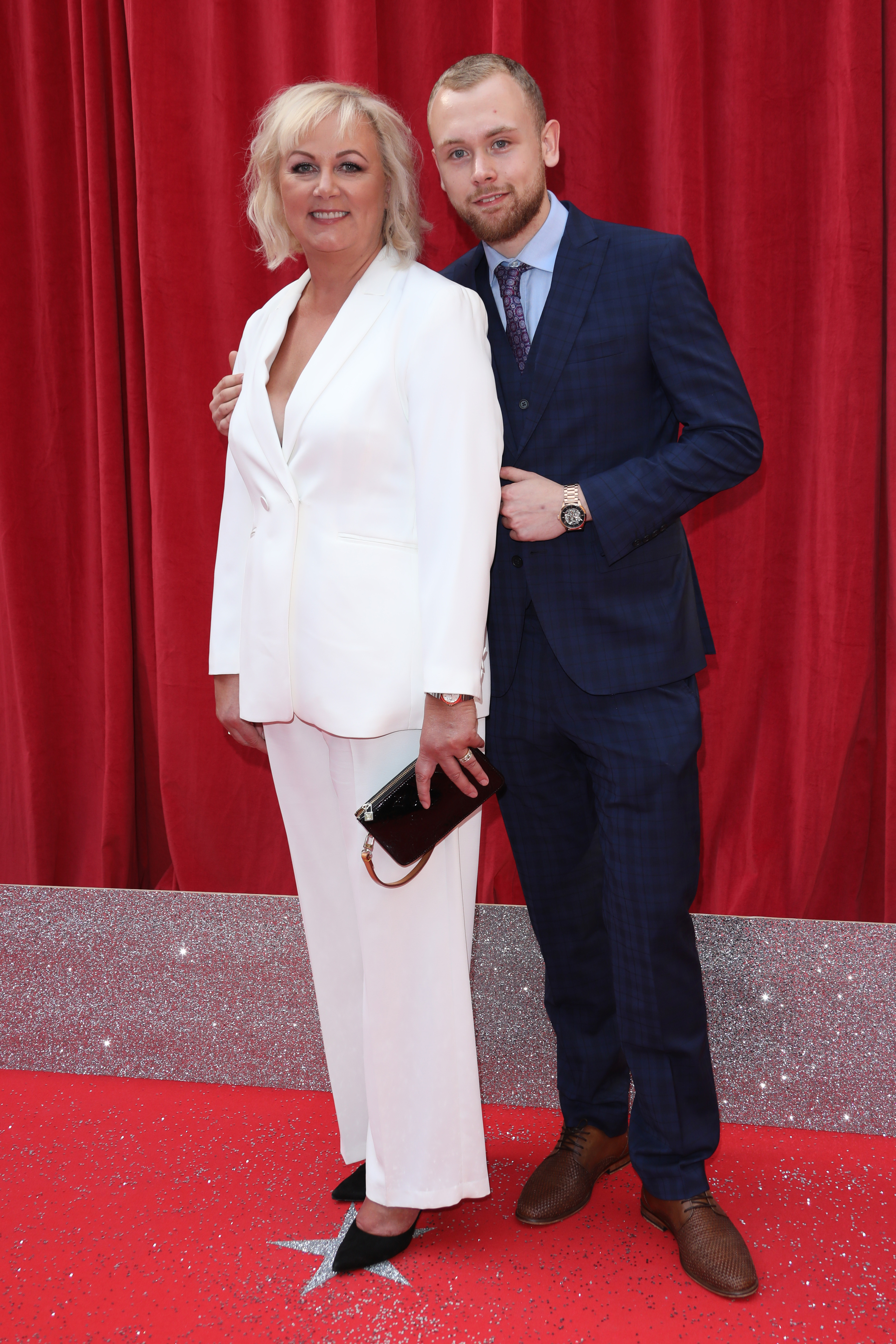 34334593 Headline : The British Soap Awards 2018 Caption : The British Soap Awards 2018 held at the Hackney Empire - Arrivals PersonInImage : Sue Cleaver,Elliot Quinn Credit : Lia Toby/WENN.com
