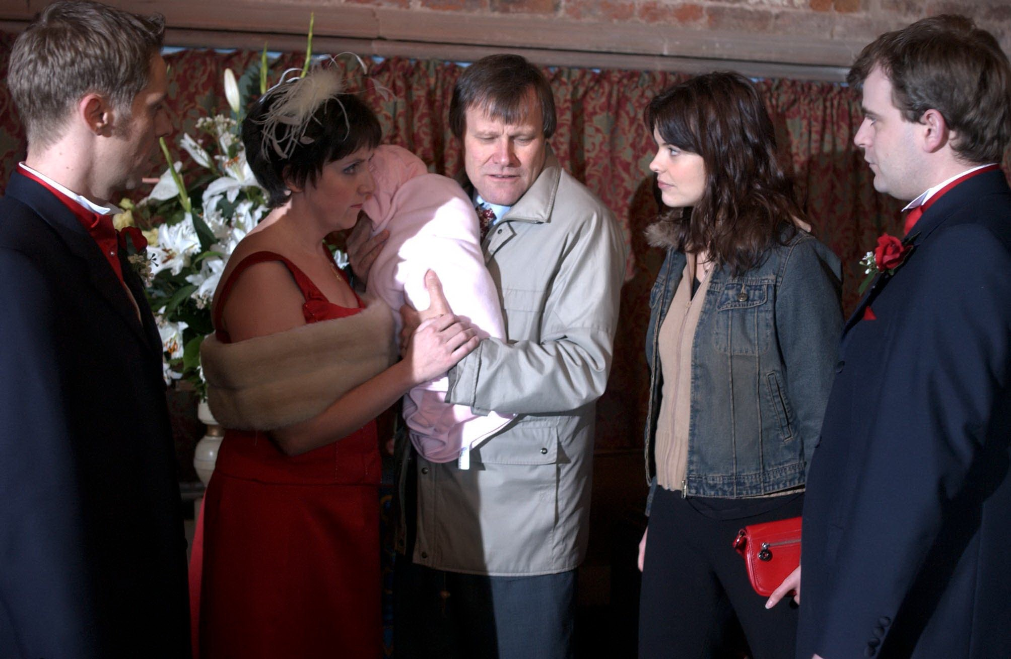 2004 - The day of Karen and Steve's Wedding has arrived, but with Tracy Barlow determined to upset the day's proceedings it's bound to be a memorable day. However, will this be the happiest day of their lives? PICTURED: Andy McDonald (NICK COCHRANE), Hayley Cropper (JULIE HESMONDHALGH), Roy Cropper (DAVID NEILSON), Tracy Barlow (KATE FORD) and Steve McDonald (SIMON GREGSON). ITV ARCHIVE