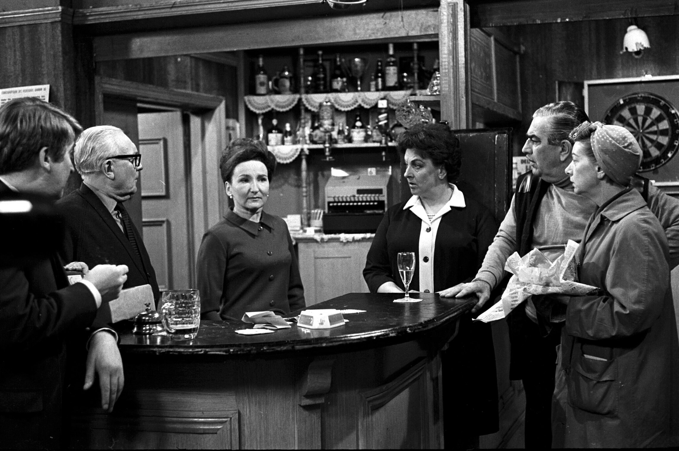 Editorial use only. Exclusive - Premium Rates Apply. Call your Account Manager for pricing. Mandatory Credit: Photo by ITV/REX/Shutterstock (669448pz) 'Coronation Street' TV - 1969 - L-R Len Fairclough [Peter Adamson], Jack Walker [Arthur Leslie], Emily Nugent [Eileen Derbyshire], Betty Turpin [Betty Driver], Stan Ogden [Bernard Youens] and Hilda Ogden [Jean Alexander] in the Rovers. ITV ARCHIVE