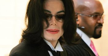 MICHAEL JACKSON arriving at lawyer Johnnie L Cochran's funeral at West Angeles Cathedral