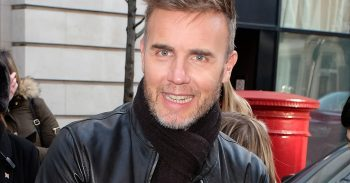 Gary Barlow greets fans as he leaves BBC Radio 2 in London