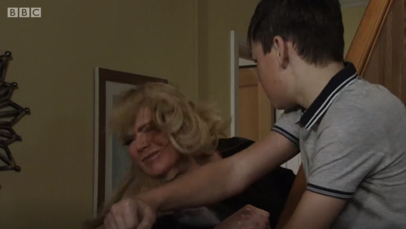 EAstEnders Denny punches Sharon Credit: BBC