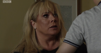 EastEnders Sharon punched by Denny Credit: BBC