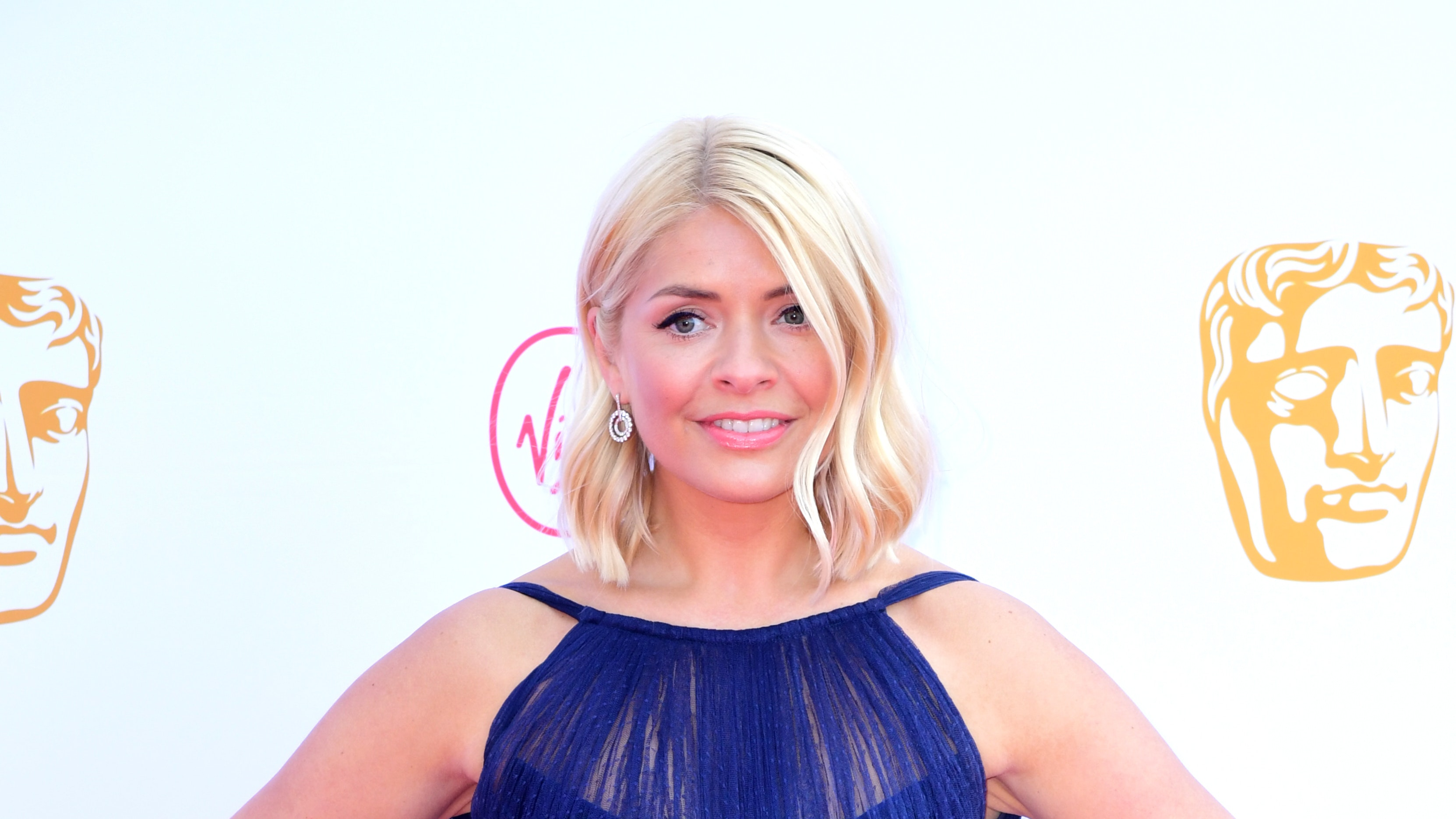 Holly Willoughby celebrates BAFTA TV win with her sister