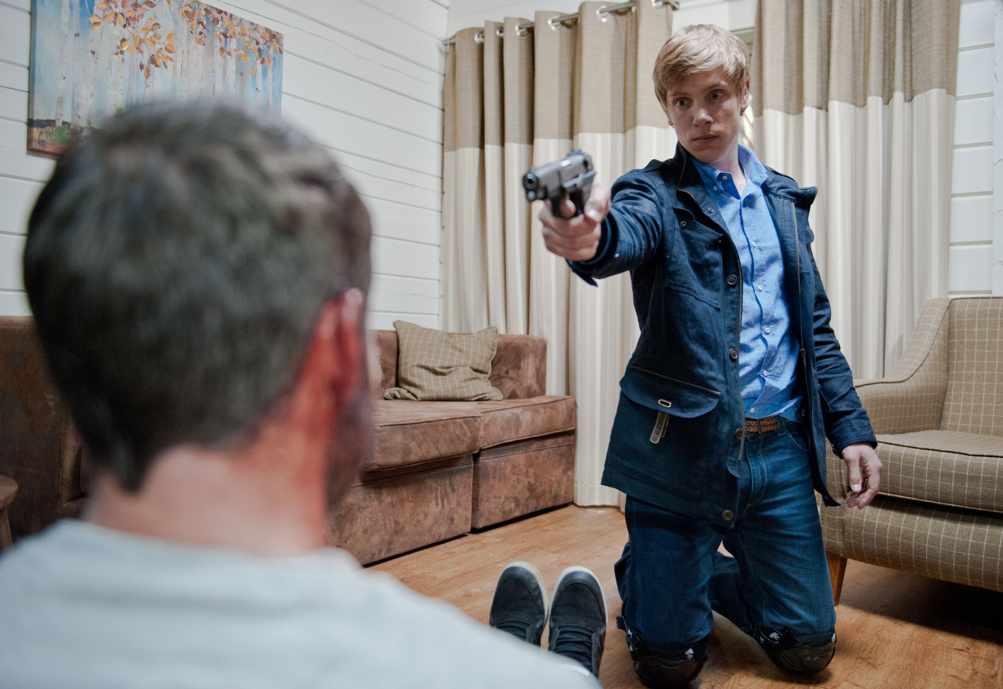 Editorial use only Mandatory Credit: Photo by ITV/REX/Shutterstock (8842199ag) Captured and threatening to expose Robert over Katie's killing, Aaron calls a psychopath. Robert responds by producing a gun. He claims he feels guilt for Andy for ruining his life, but starts to lose control when Aaron begins goading him. Pointing the gun at Aaron, Robert realises he can't bring himself to shoot Aaron. Suddenly, Paddy bursts into the holiday lodge taking Robert by surprise who turns round sharply, firing at Paddy. Paddy collapses to the floor- With Robert Sugden, as played by Ryan Hawley, and Aaron Livesy, as played by Danny Miller. (Ep 7242 - 23rd July 2015). 'Emmerdale' TV Series - Jul 2015 Emmerdale Farm is a long-running British soap opera set in Emmerdale, a fictional village in the Yorkshire Dales. Created by Kevin Laffan, it first broadcast on 16 October 1972 and produced by ITV Yorkshire.