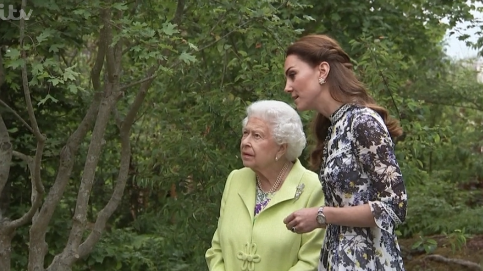 The Queen recycles royal wedding outfit during outing with Kate and William