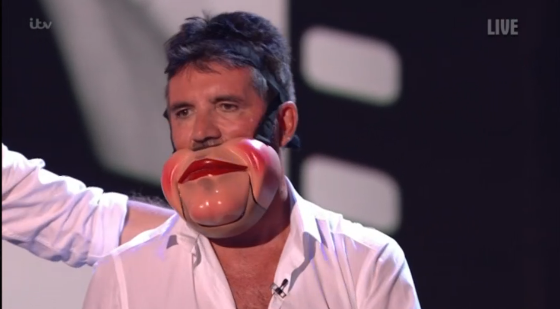 Viewers stunned as Simon Cowell storms off stage when BGT act tries to make him dance