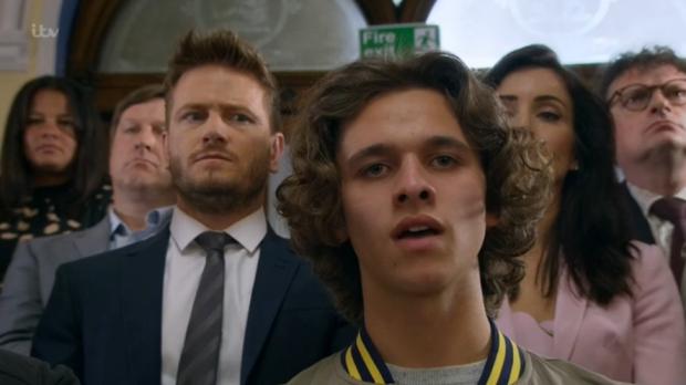 Jacob at Maya's trial