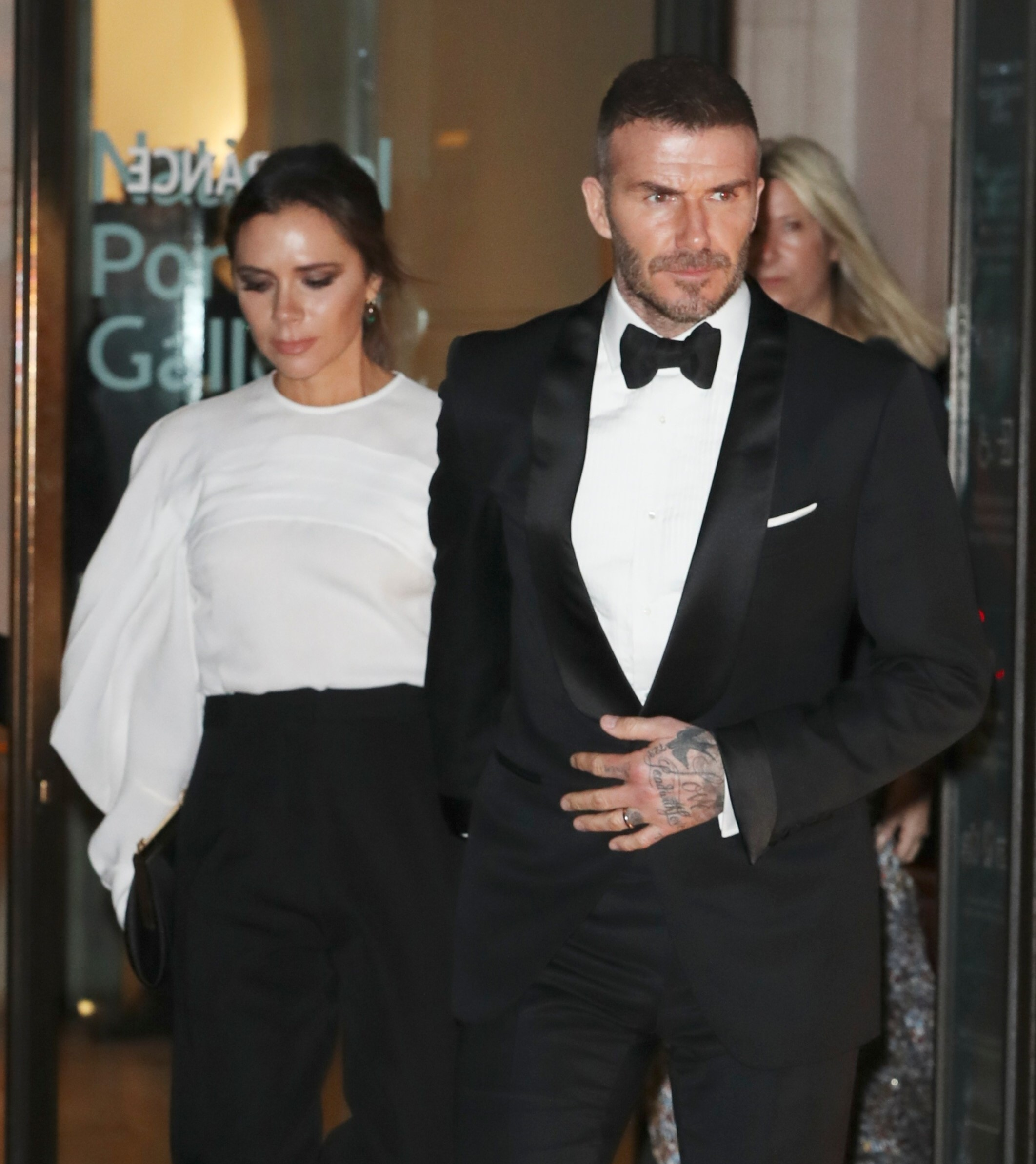 David and Victoria Beckham leaving the Portrait Gala at the National Portrait Gallery, London Pictured: Victoria Beckham,David Beckham Ref: SPL5071919 130319 NON-EXCLUSIVE Picture by: SplashNews.com Splash News and Pictures Los Angeles: 310-821-2666 New York: 212-619-2666 London: 0207 644 7656 Milan: 02 4399 8577 photodesk@splashnews.com World Rights