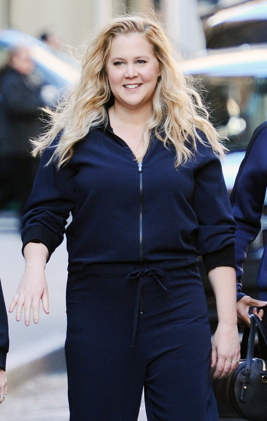 Pregnant Amy Schumer is seen on set of a commercial wearing a tracksuit in New York, NY. Pictured: Amy Schumer Ref: SPL5036624 251018 NON-EXCLUSIVE Picture by: SplashNews.com Splash News and Pictures Los Angeles: 310-821-2666 New York: 212-619-2666 London: 0207 644 7656 Milan: 02 4399 8577 photodesk@splashnews.com World Rights