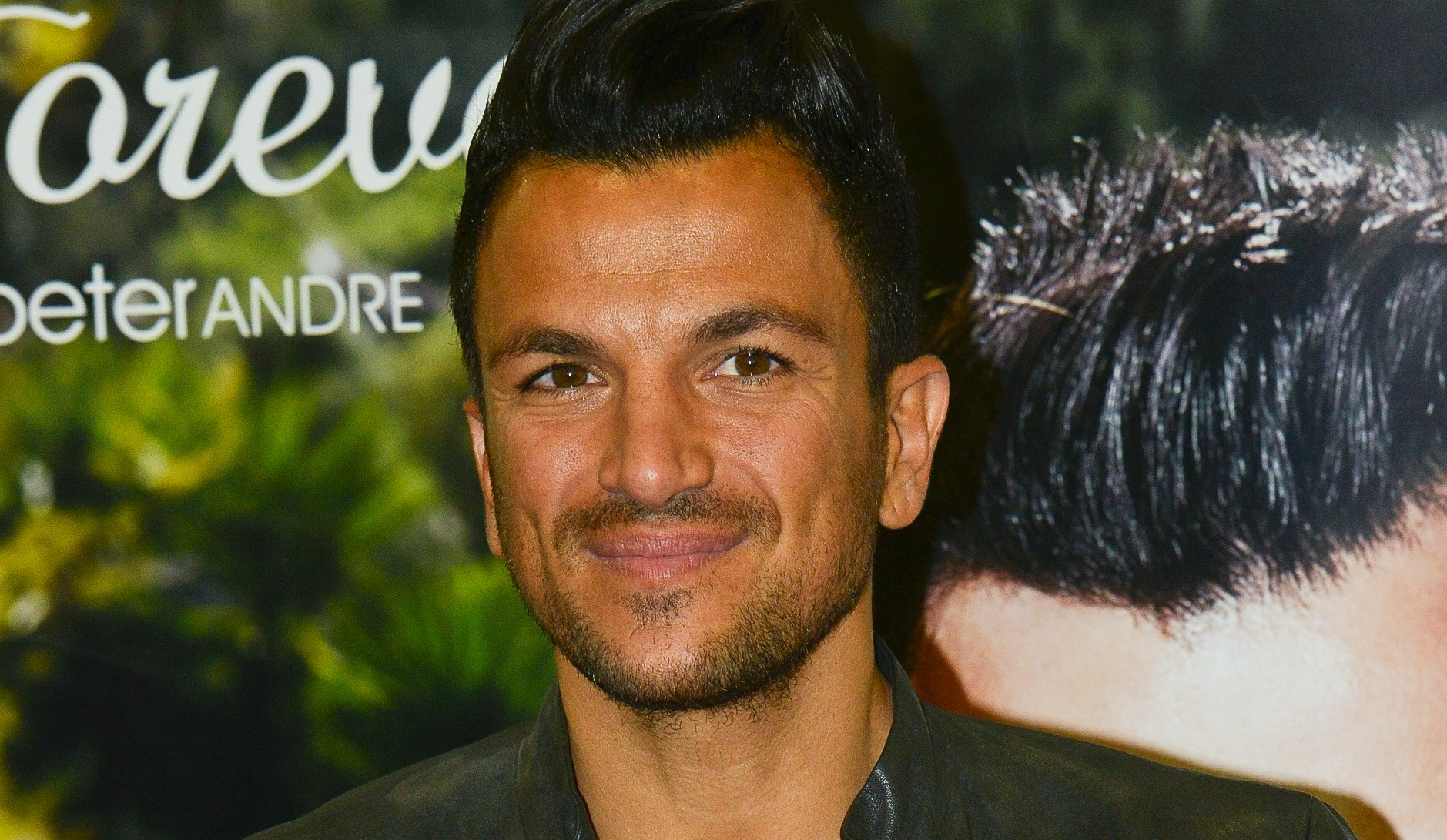Peter Andre admits that he didn't get much sleep on his wedding anniversary