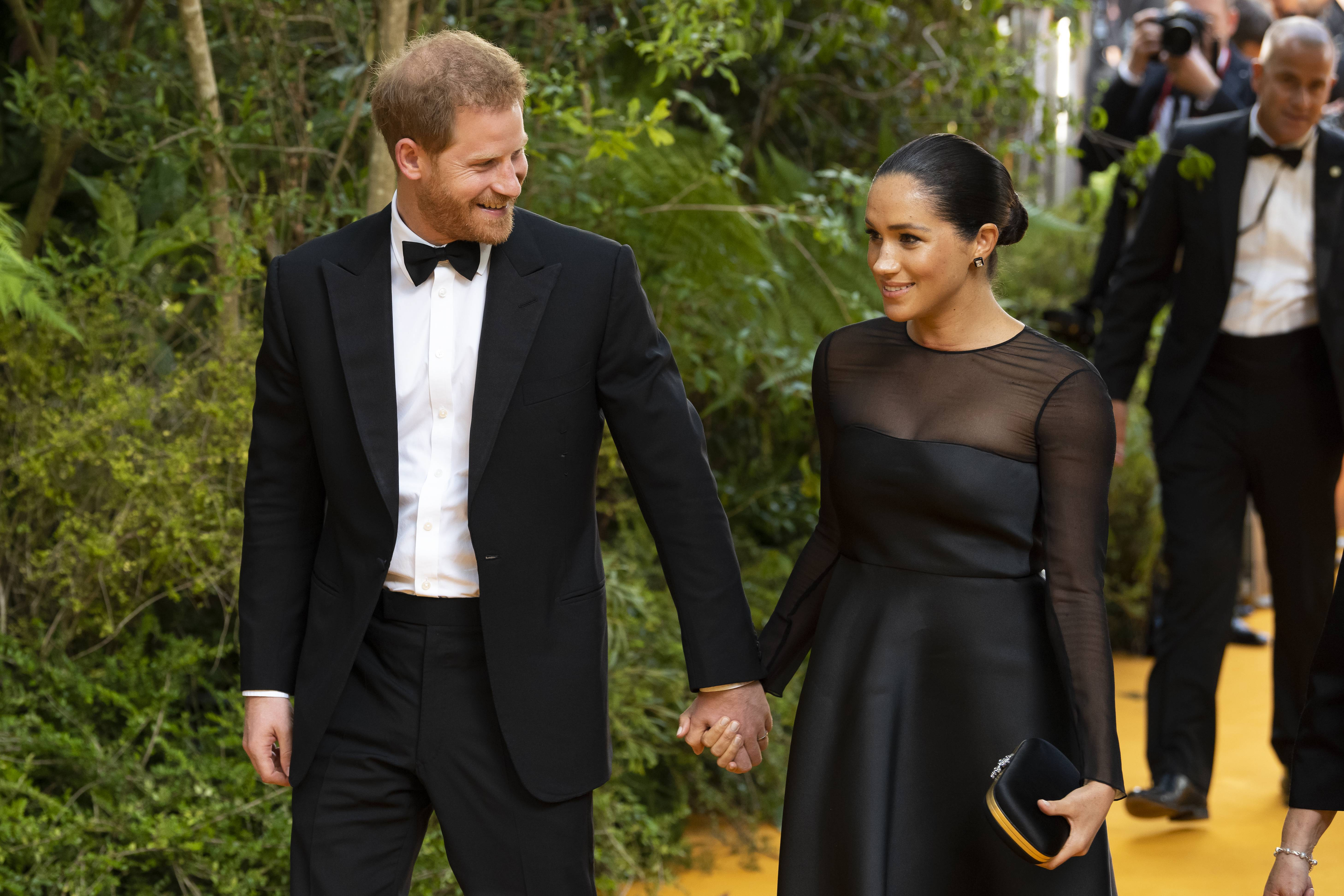 The Royal Family accused of 'throwing Meghan Markle under the bus'