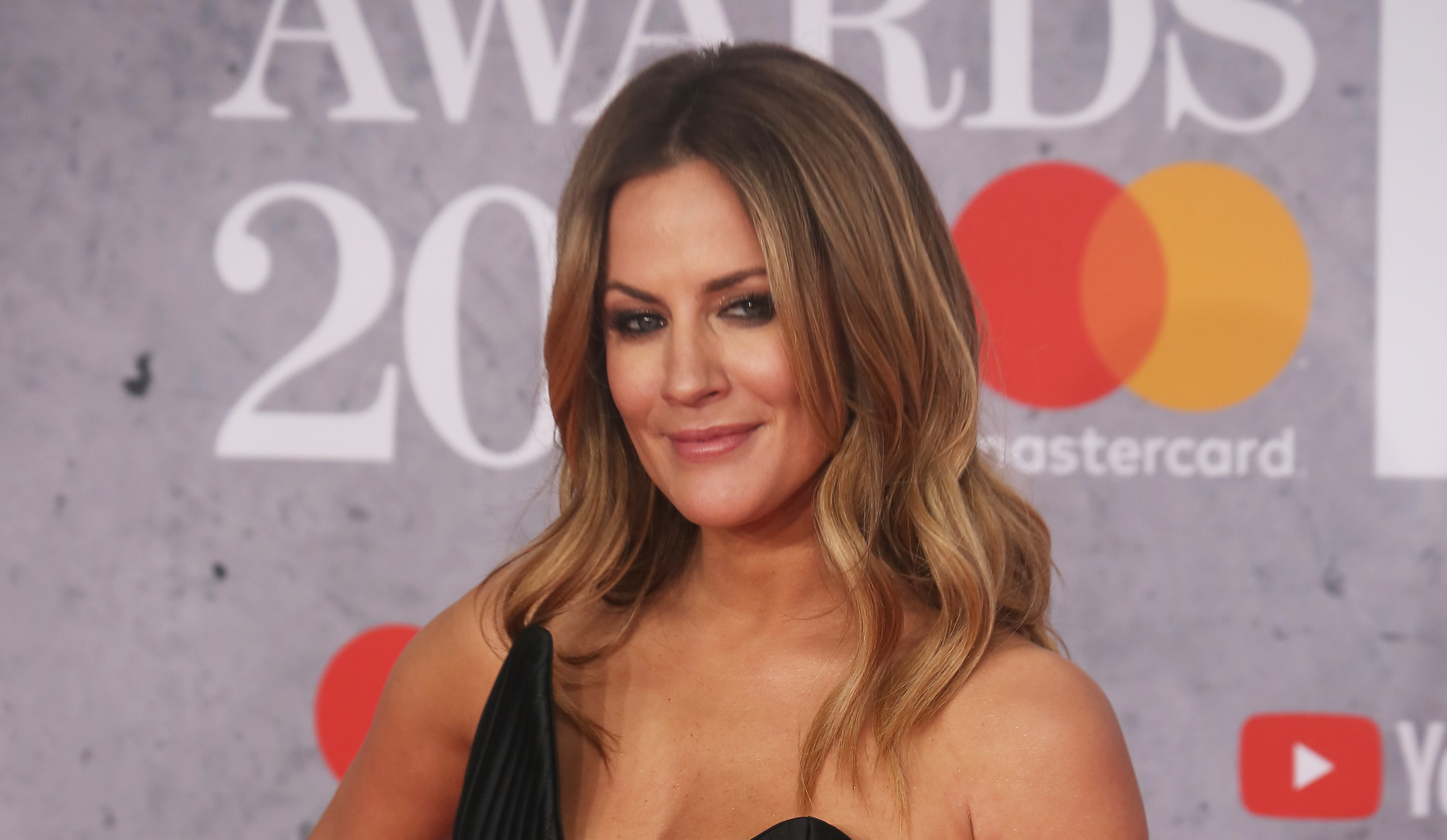 Caroline Flack's new beau Lewis Burton is 'on the rebound' and 'playing' her, claims ex