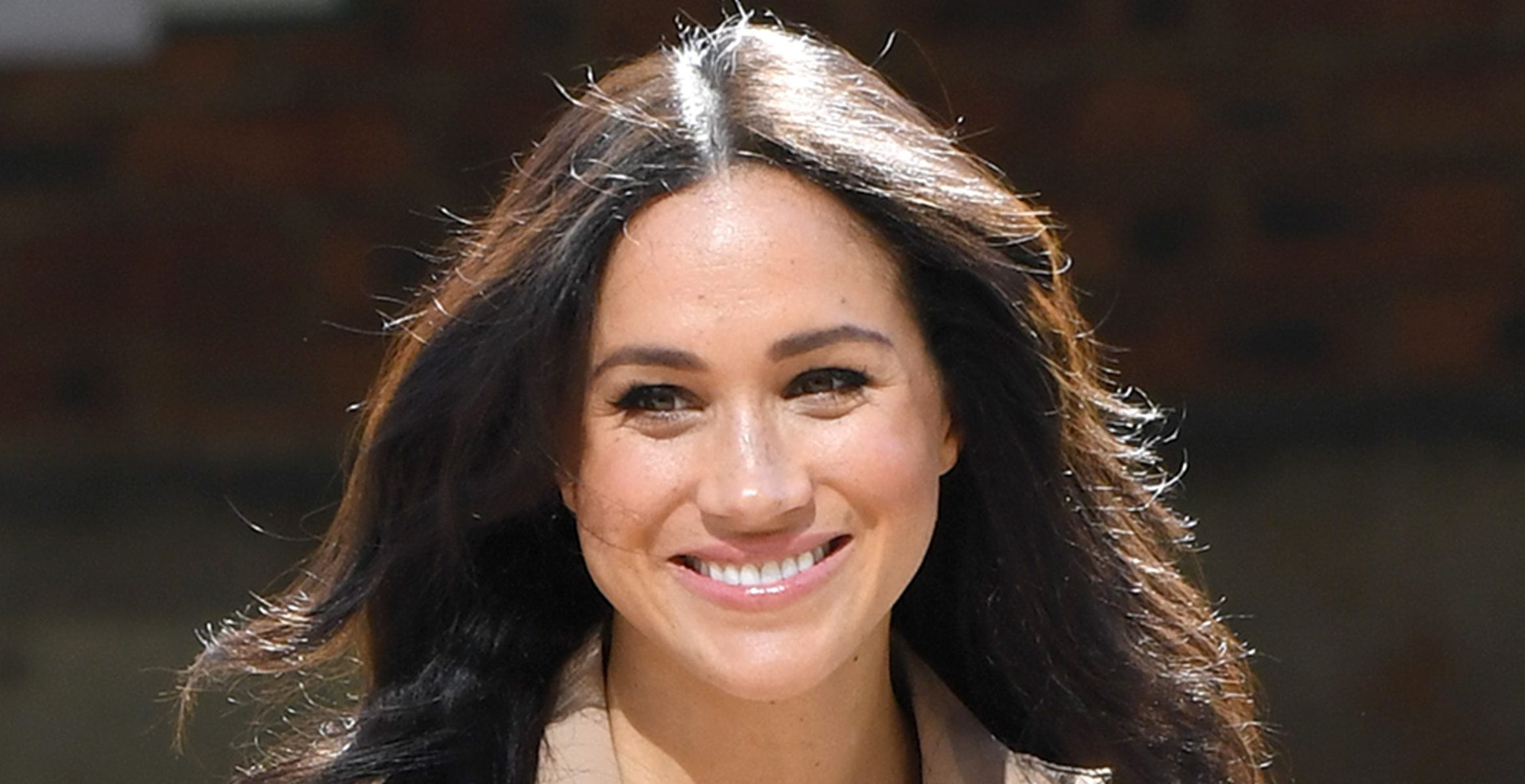 Windswept Meghan Markle battles the elements on solo royal engagement