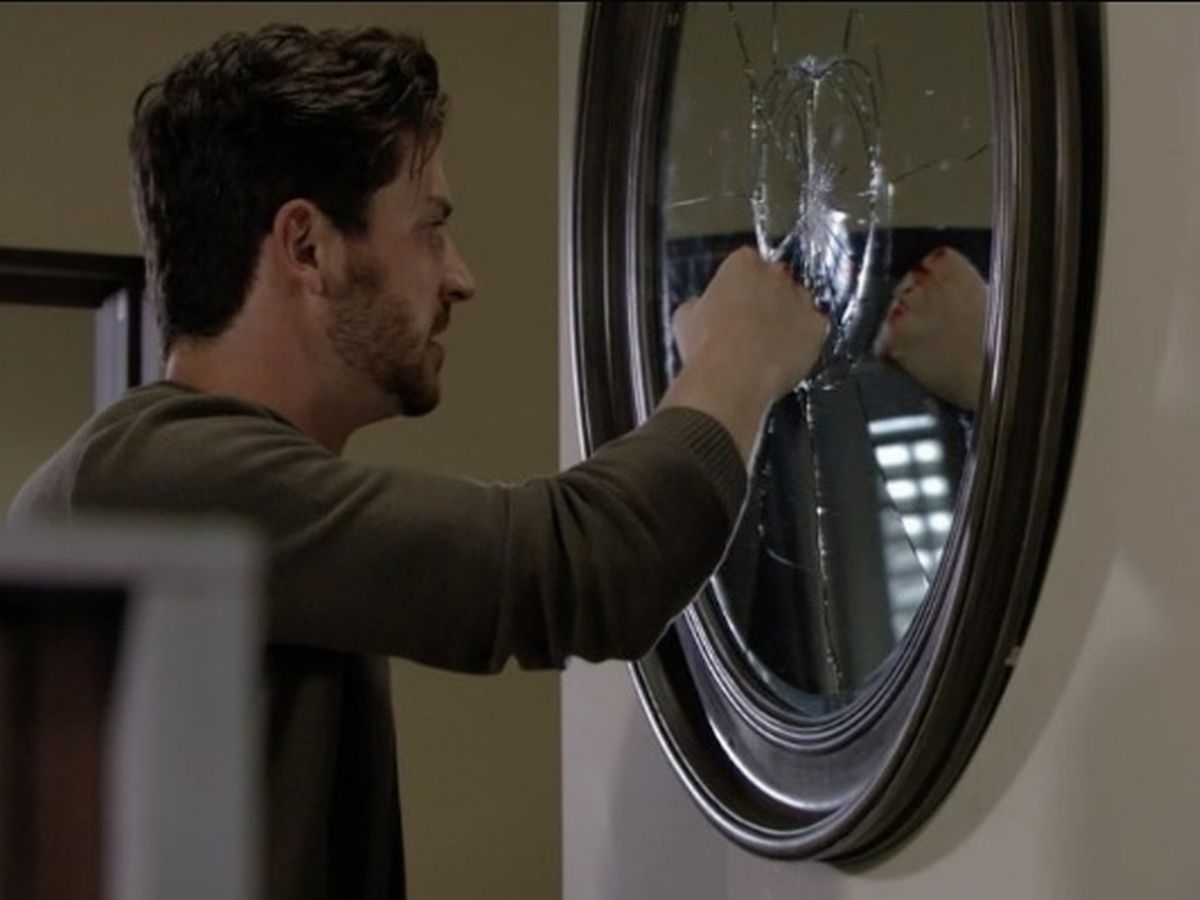 Gray punches a mirror in EastEnders