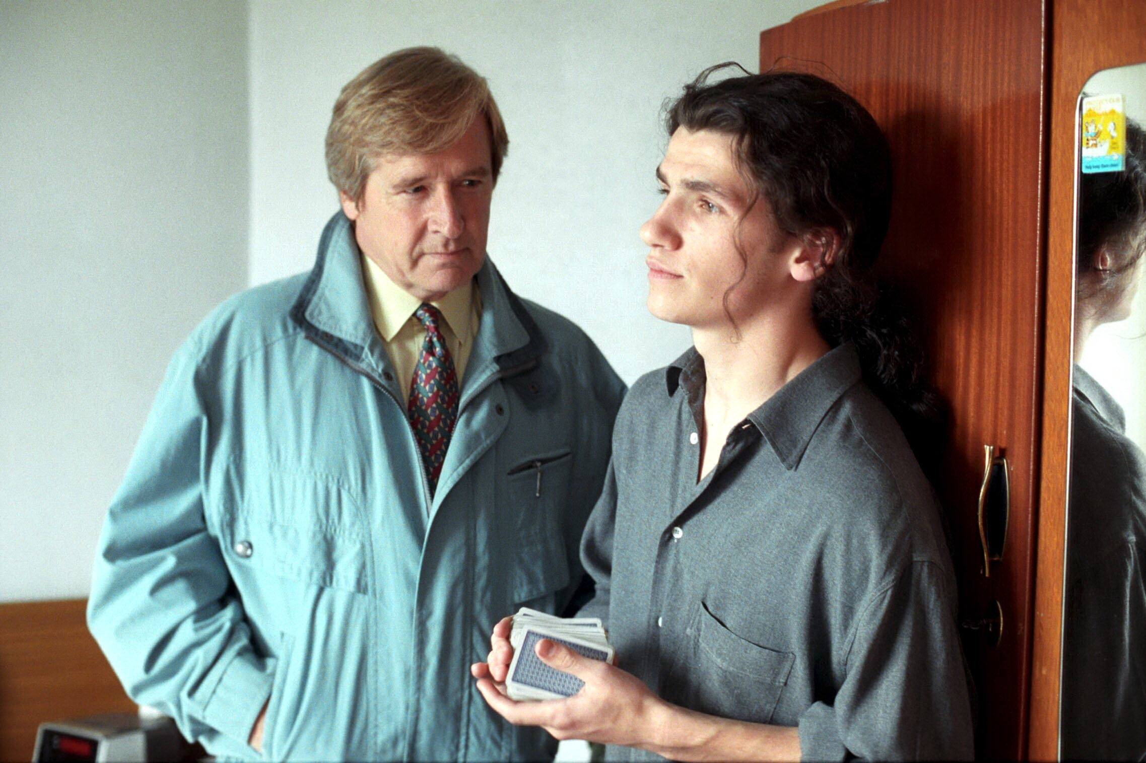 Editorial use only. Exclusive - Premium Rates Apply. Call your Account Manager for pricing. Mandatory Credit: Photo by ITV/Shutterstock (669486oz) 'Coronation Street' TV - 1993 - Ken Barlow [William Roache] calls at Tracy's flat and meets her boyfriend Craig Lee [Kieran O'Brien]. ITV ARCHIVE