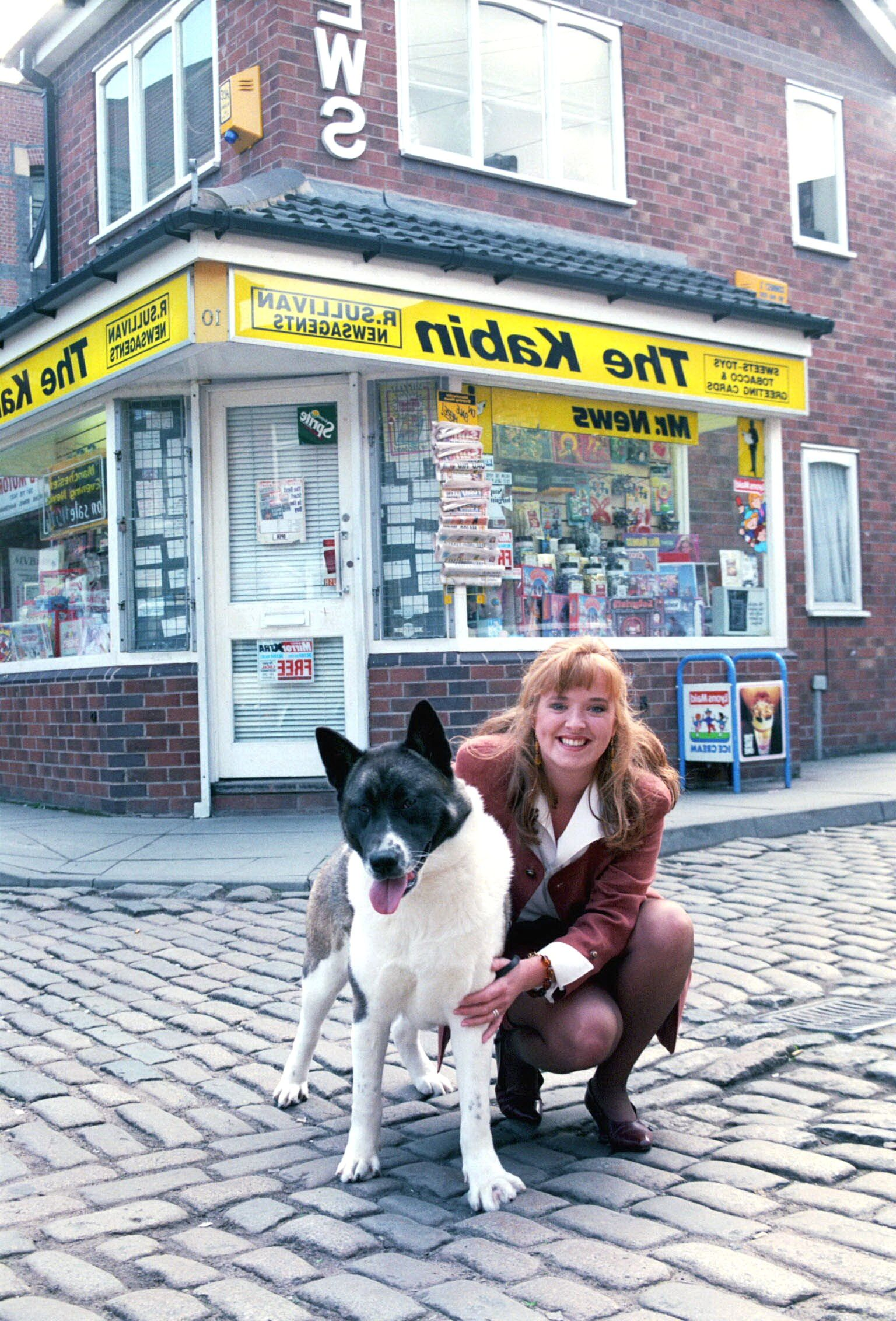 Editorial use only. Exclusive - Premium Rates Apply. Call your Account Manager for pricing. Mandatory Credit: Photo by ITV/Shutterstock (669637y) 'Coronation Street' TV - 1993 - Jenny Bradley [Sally Ann Matthews] returns to the Street with a Japanese Akita. Dog. ITV ARCHIVE