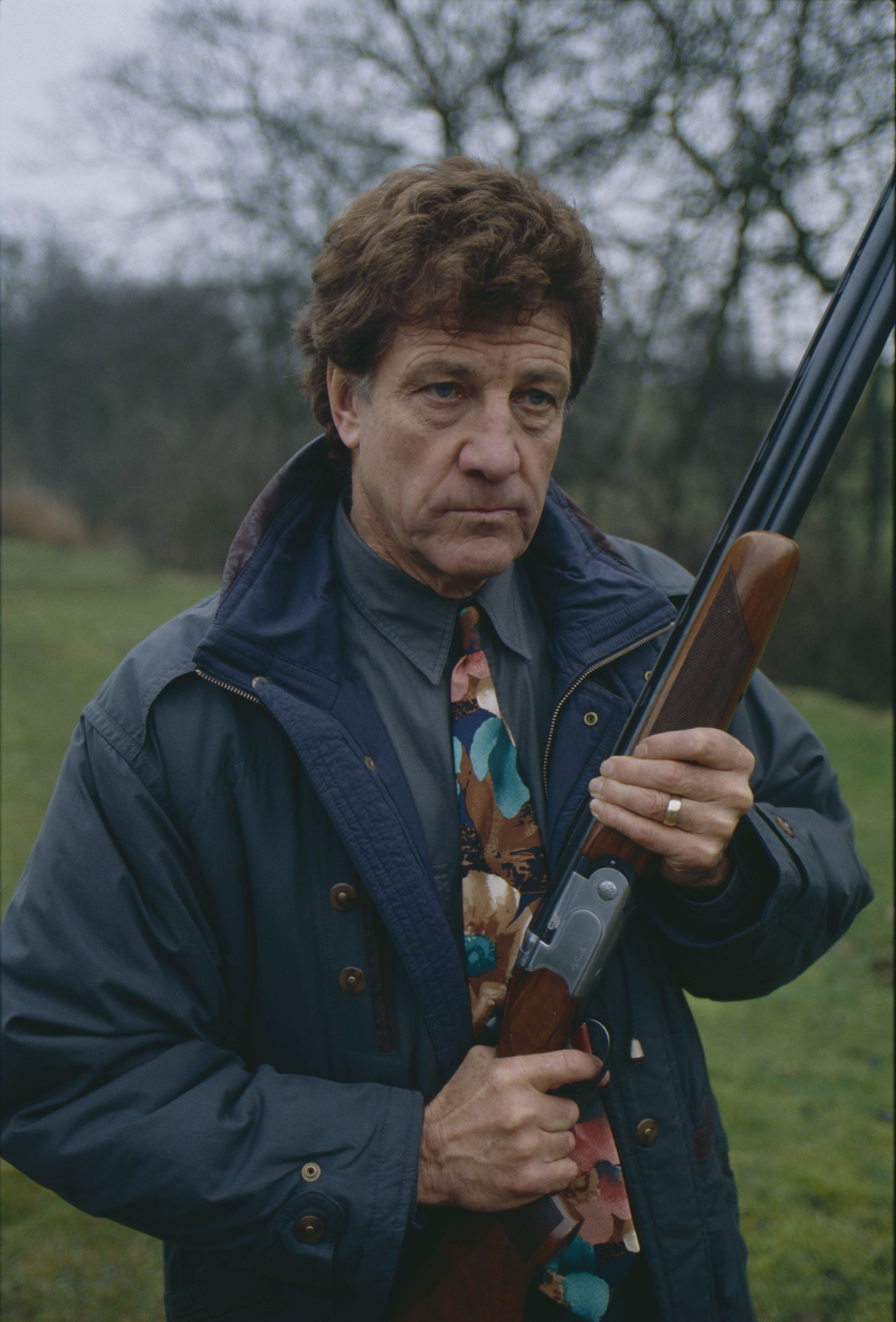 Editorial use only Mandatory Credit: Photo by ITV/Shutterstock (8067069i) Norman Bowler (as Frank Tate) as Frank threatens Pollard with a gun (Ep 1752 - 1st April 1993) 'Emmerdale' TV Series - 01 Apr 1993 Emmerdale Farm is a long-running British soap opera set in Emmerdale, a fictional village in the Yorkshire Dales. Created by Kevin Laffan, it first broadcast on 16 October 1972 and produced by ITV Yorkshire.