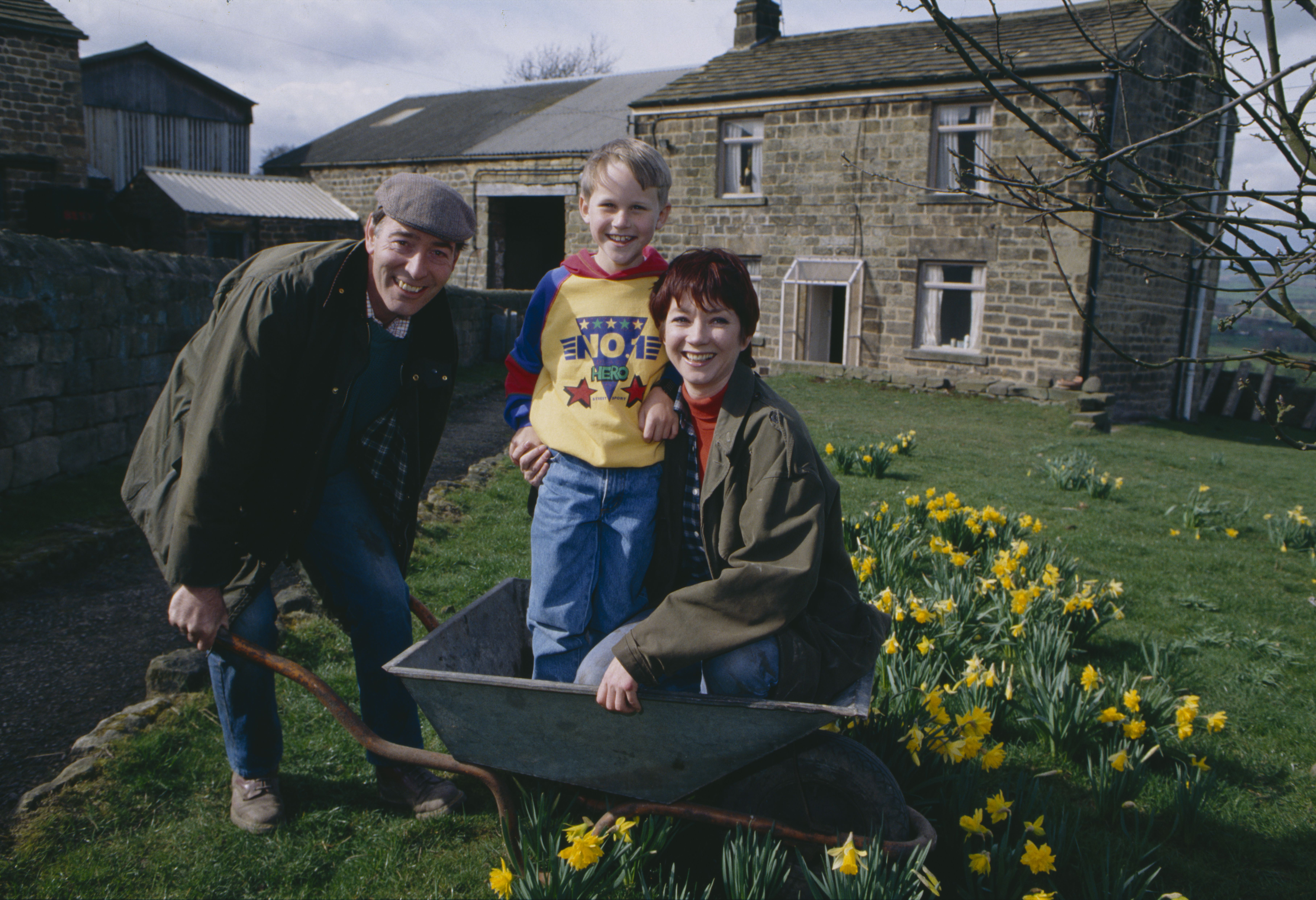 Editorial use only Mandatory Credit: Photo by ITV/Shutterstock (8105575l) Madeleine Howard (as Sarah Connolly), Christopher Smith (as Robert Sugden) and Clive Hornby (as Jack Sugden) as the Sugdens move into Hawthorn Cottage farm (Ep 1758 - 22nd April 1993) 'Emmerdale' TV Series - - 22 Apr 1993 Emmerdale Farm is a long-running British soap opera set in Emmerdale, a fictional village in the Yorkshire Dales. Created by Kevin Laffan, it first broadcast on 16 October 1972 and produced by ITV Yorkshire.