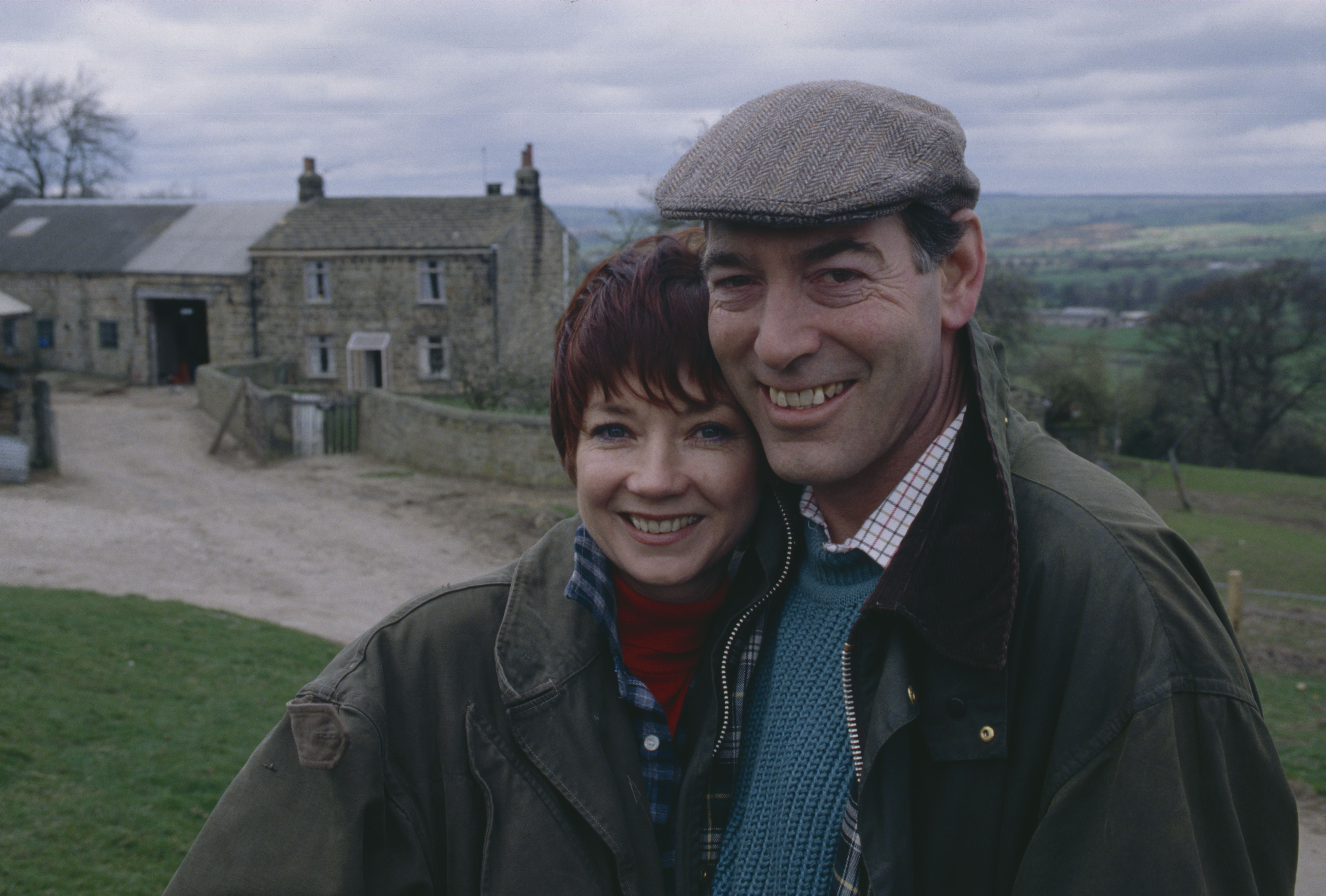 Editorial use only Mandatory Credit: Photo by ITV/Shutterstock (8105575m) Madeleine Howard (as Sarah Connolly) and Clive Hornby (as Jack Sugden) as the Sugdens move into Hawthorn Cottage farm (Ep 1758 - 22nd April 1993) 'Emmerdale' TV Series - - 22 Apr 1993 Emmerdale Farm is a long-running British soap opera set in Emmerdale, a fictional village in the Yorkshire Dales. Created by Kevin Laffan, it first broadcast on 16 October 1972 and produced by ITV Yorkshire.