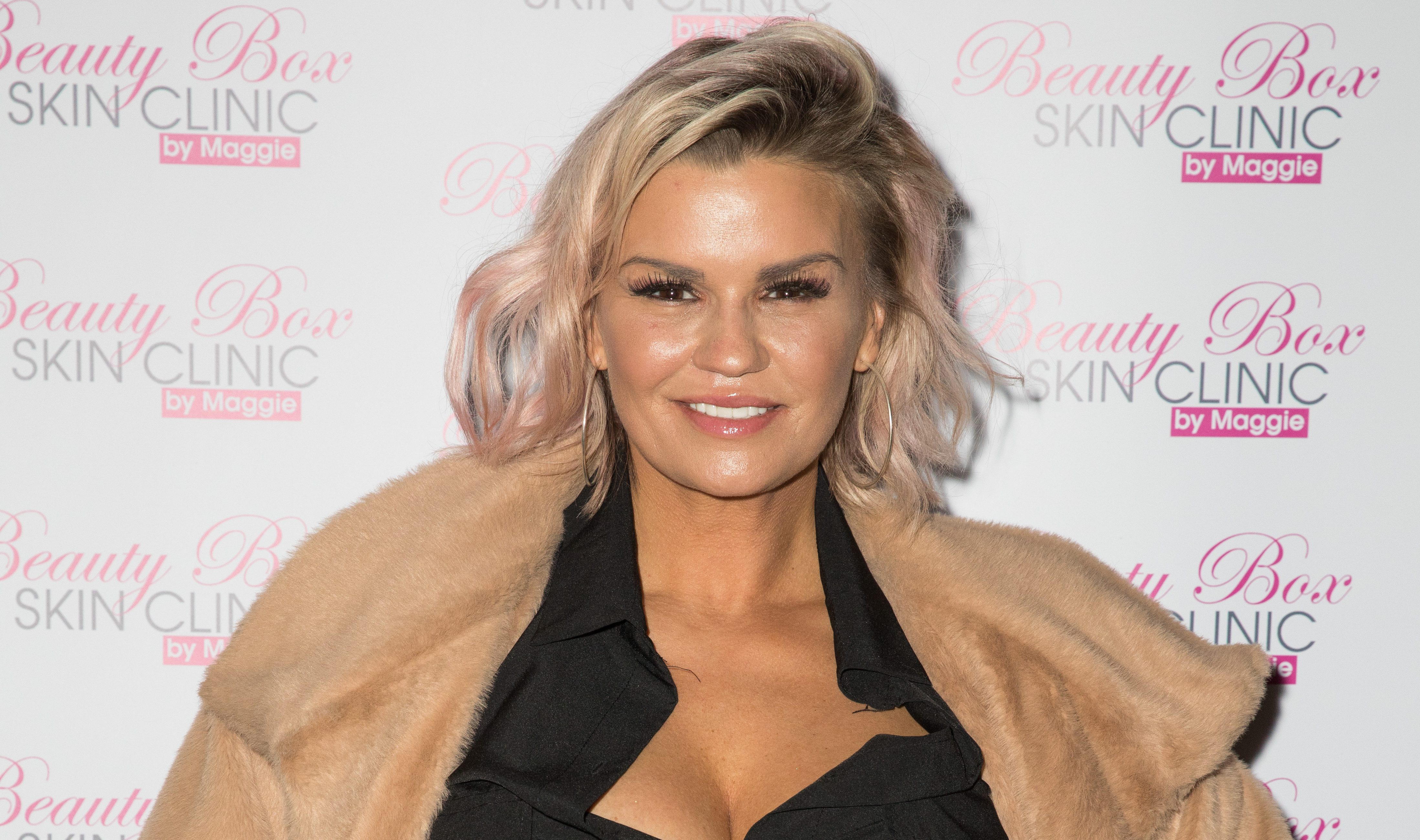 Kerry Katona is hooked up to a drip as she spends the night in hospital for mystery illness