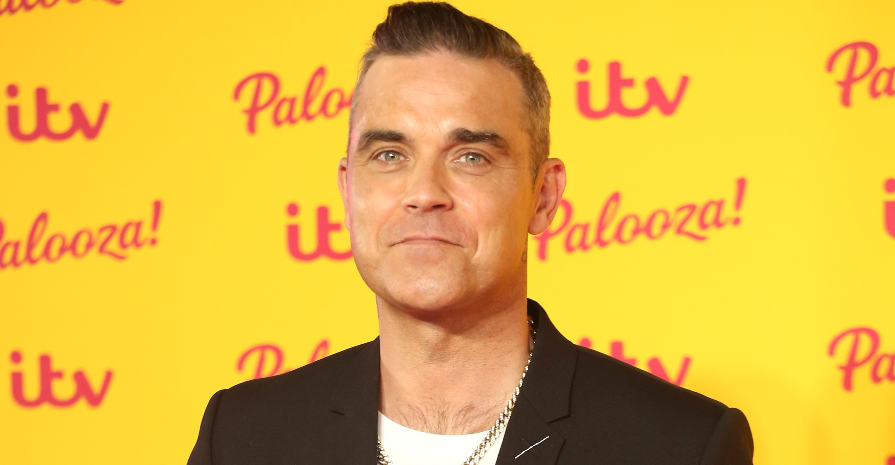 Robbie Williams strips off to reveal something huge