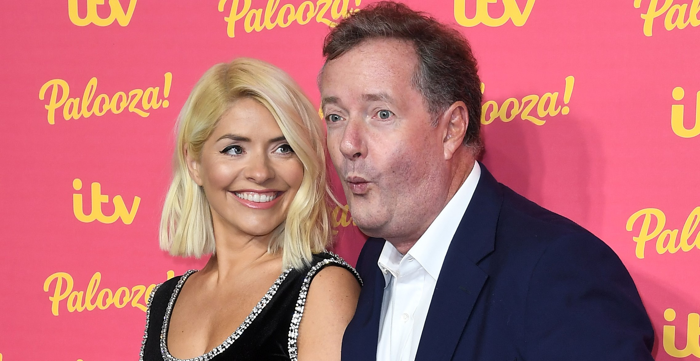 Holly Willoughby shoves Piers Morgan as he attempts to 'wreck' her red carpet moment