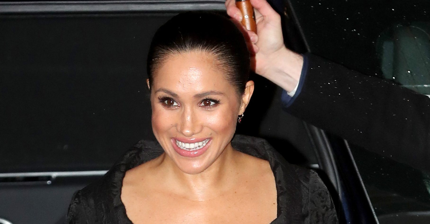 New unseen photo shows relaxed Meghan laughing with her charity pals