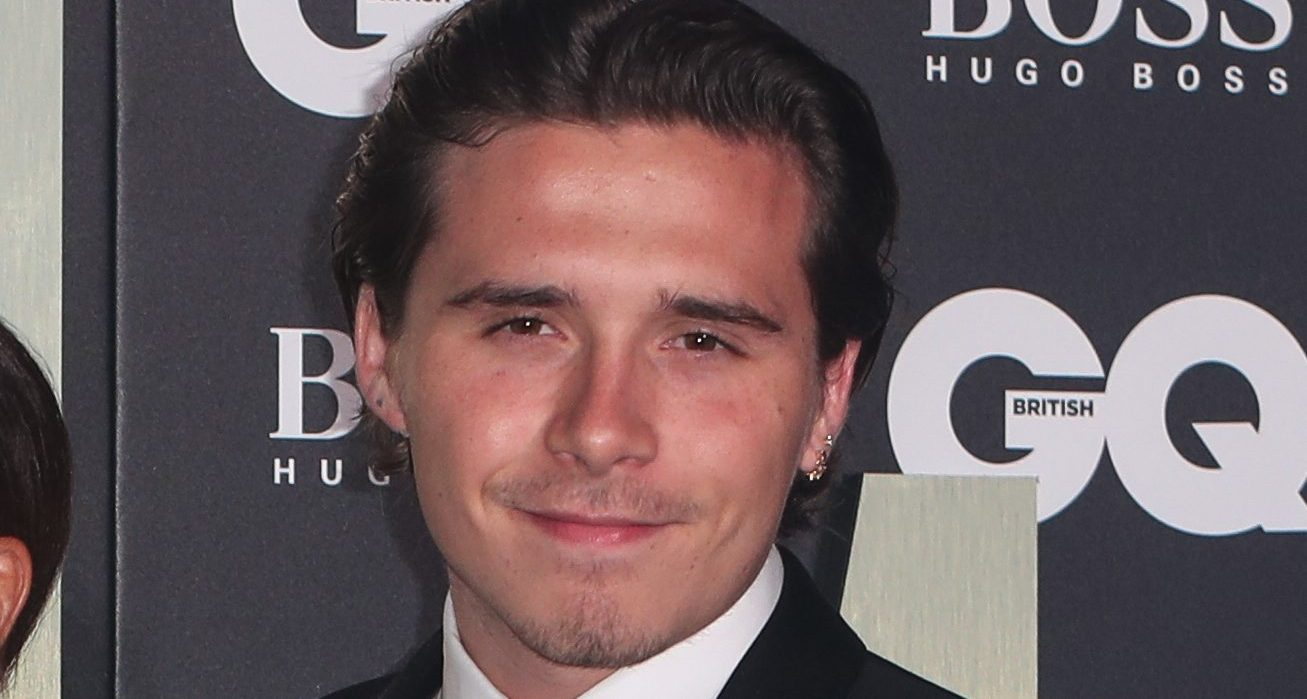 Brooklyn Beckham seals his new romance with a steamy kiss