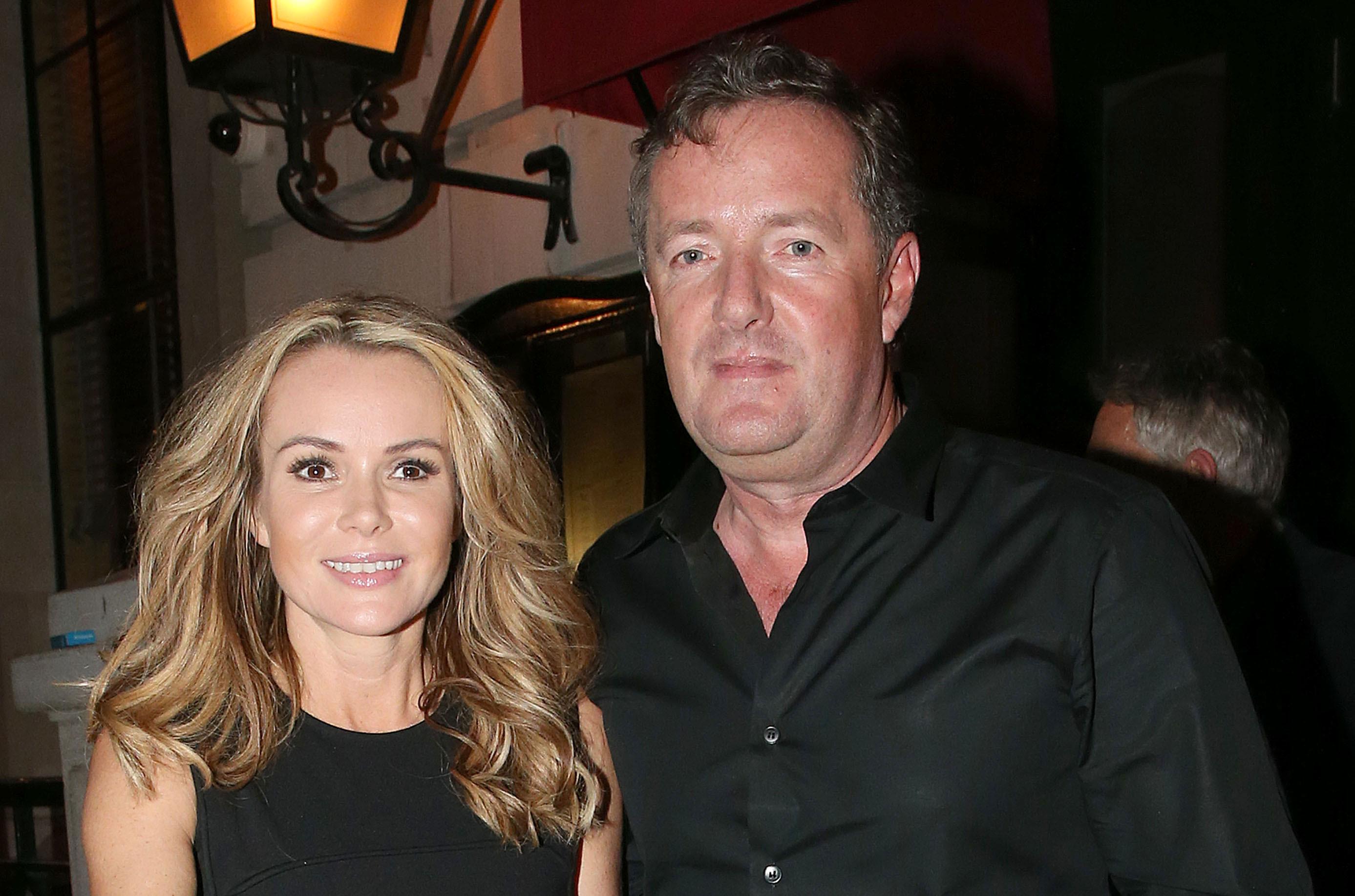 Grinning Piers Morgan mocks injured Amanda Holden during night out
