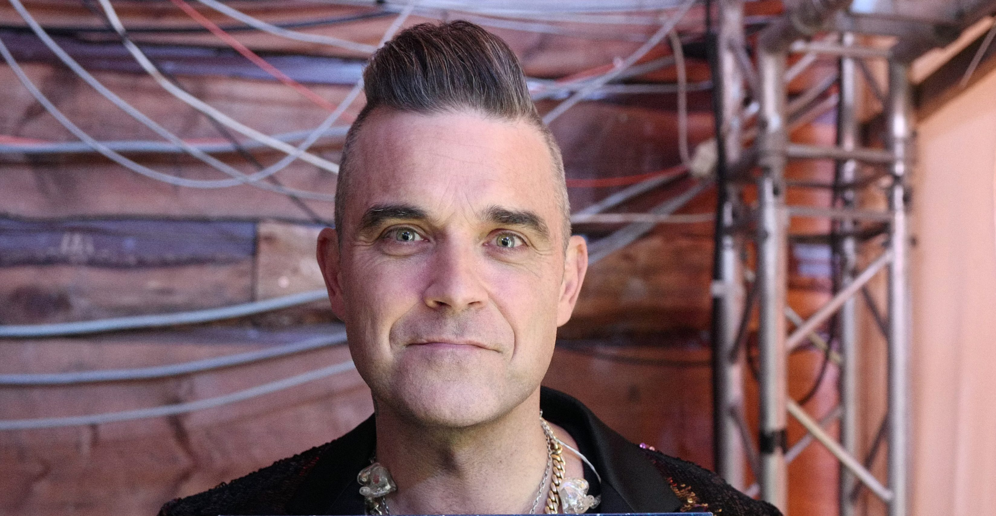 Robbie Williams hints that he's too 'expensive' to return to The X Factor