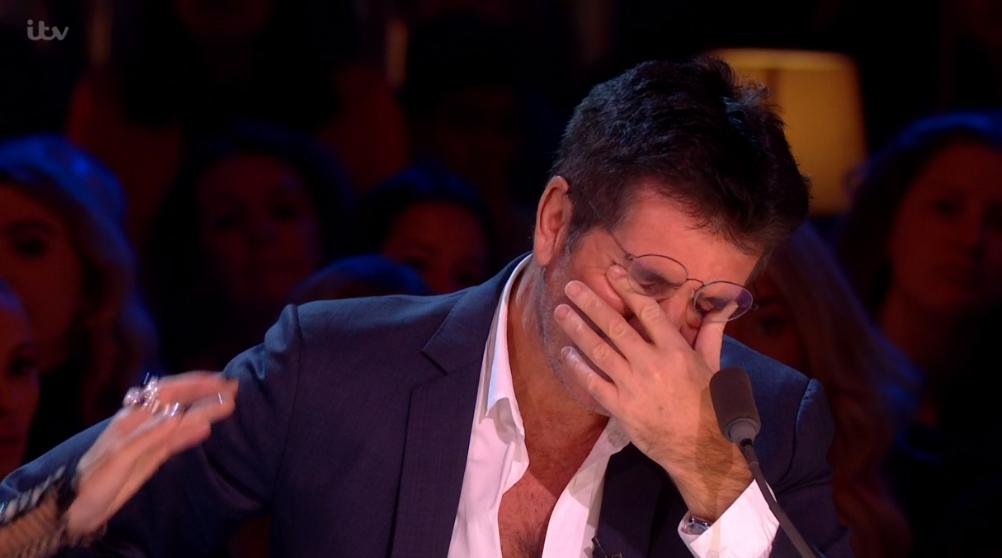 Simon Cowell comforted by partner Lauren as he breaks down in tears on X Factor: Celebrity