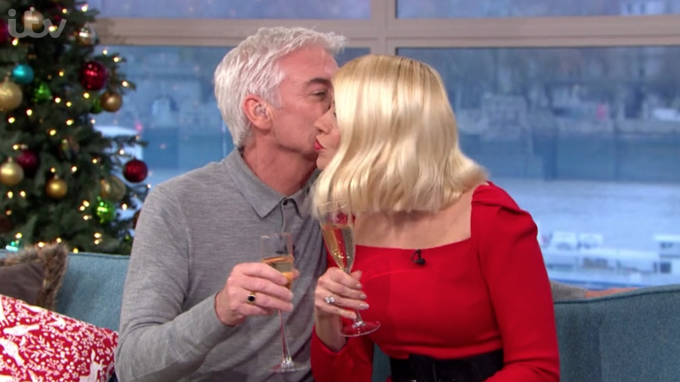 Phillip Schofield kisses and puts his arm around Holly Willoughby on This Morning amid 'feud' claims