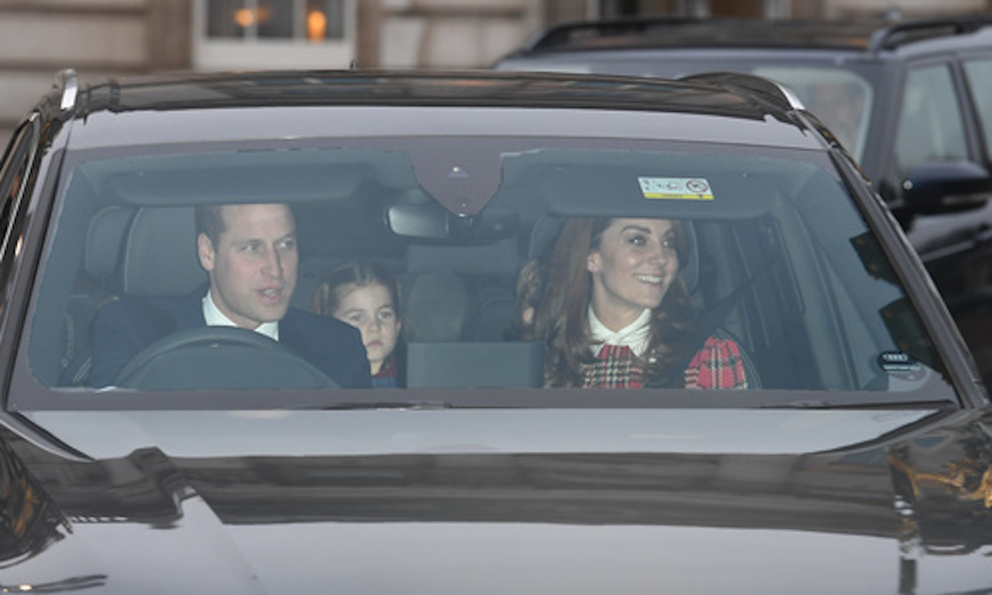 William and Kate beam as they attend Queen's Christmas lunch with George, Charlotte and Louis