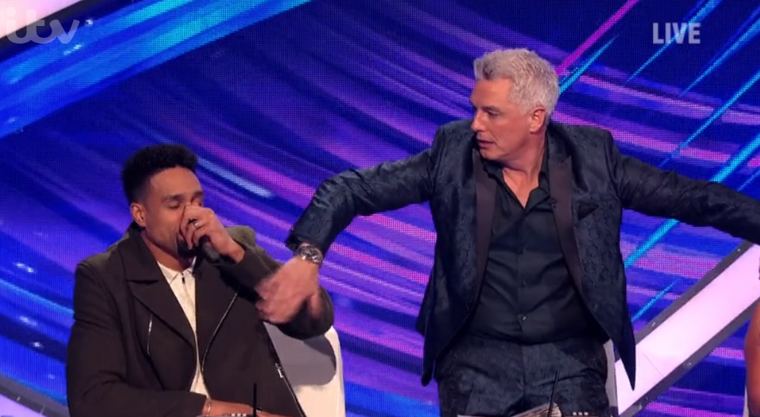 Dancing On Ice: Ashley Banjo accidentally slapped in the face by co-judge John Barrowman
