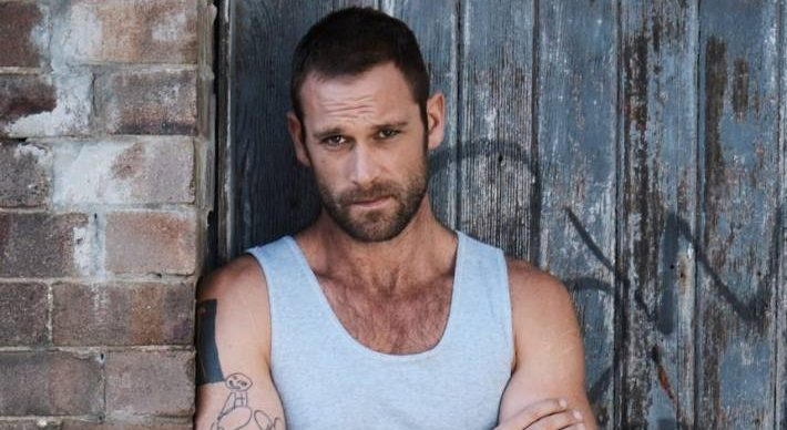 Jake Ryan as Robbo in Home And Away