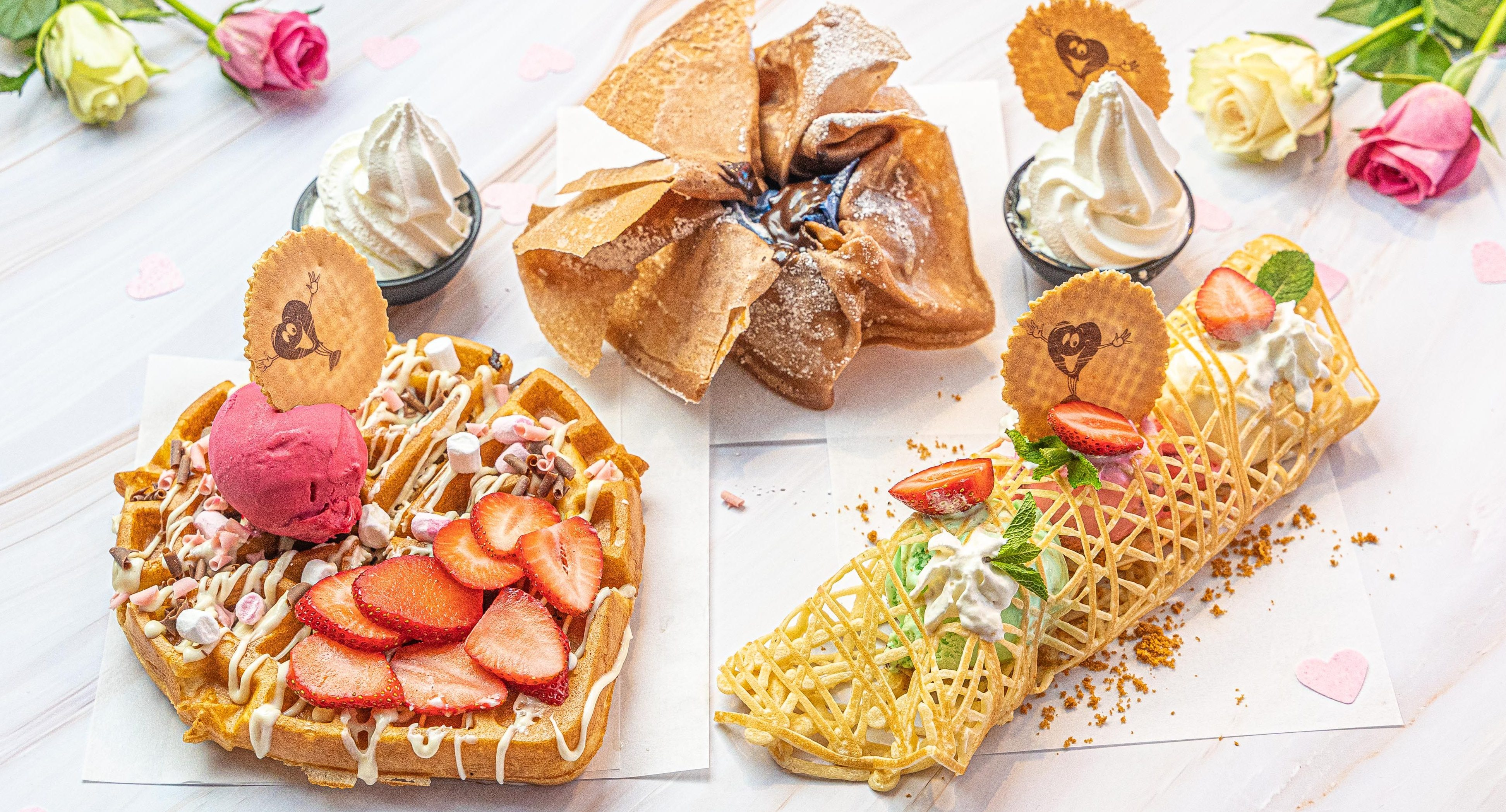 A heart-shaped waffle filled with white chocolate cookie dough is on Creams' Valentine's menu