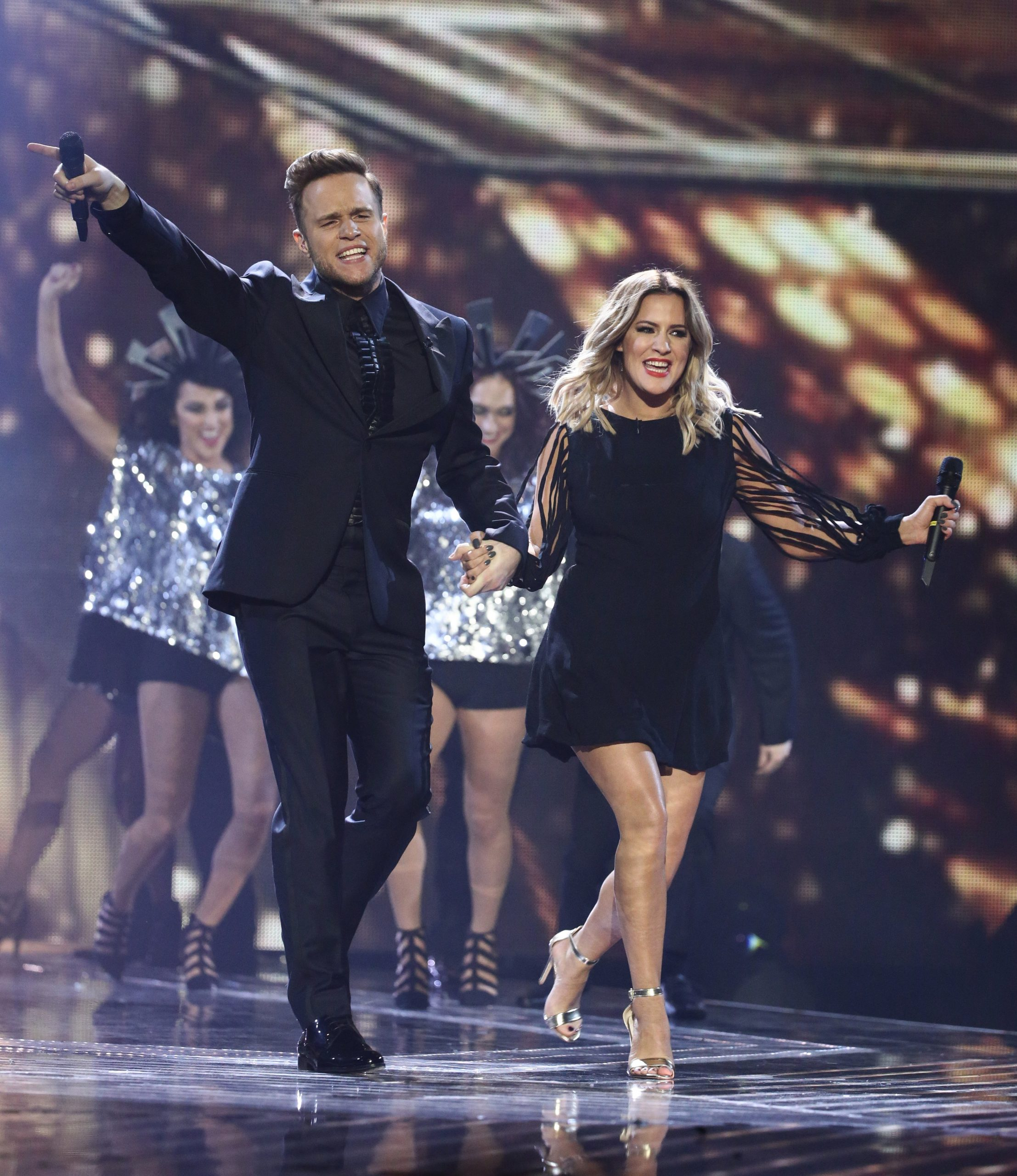 The X Factor Series Finals, London, United Kingdom - 13 December 2015 Pictured: Olly Murs,Caroline Flack,Olly Murs Caroline Flack Ref: SPL1195720 131215 NON-EXCLUSIVE Picture by: SplashNews.com Splash News and Pictures Los Angeles: 310-821-2666 New York: 212-619-2666 London: +44 (0)20 7644 7656 Berlin: +49 175 3764 166 photodesk@splashnews.com World Rights